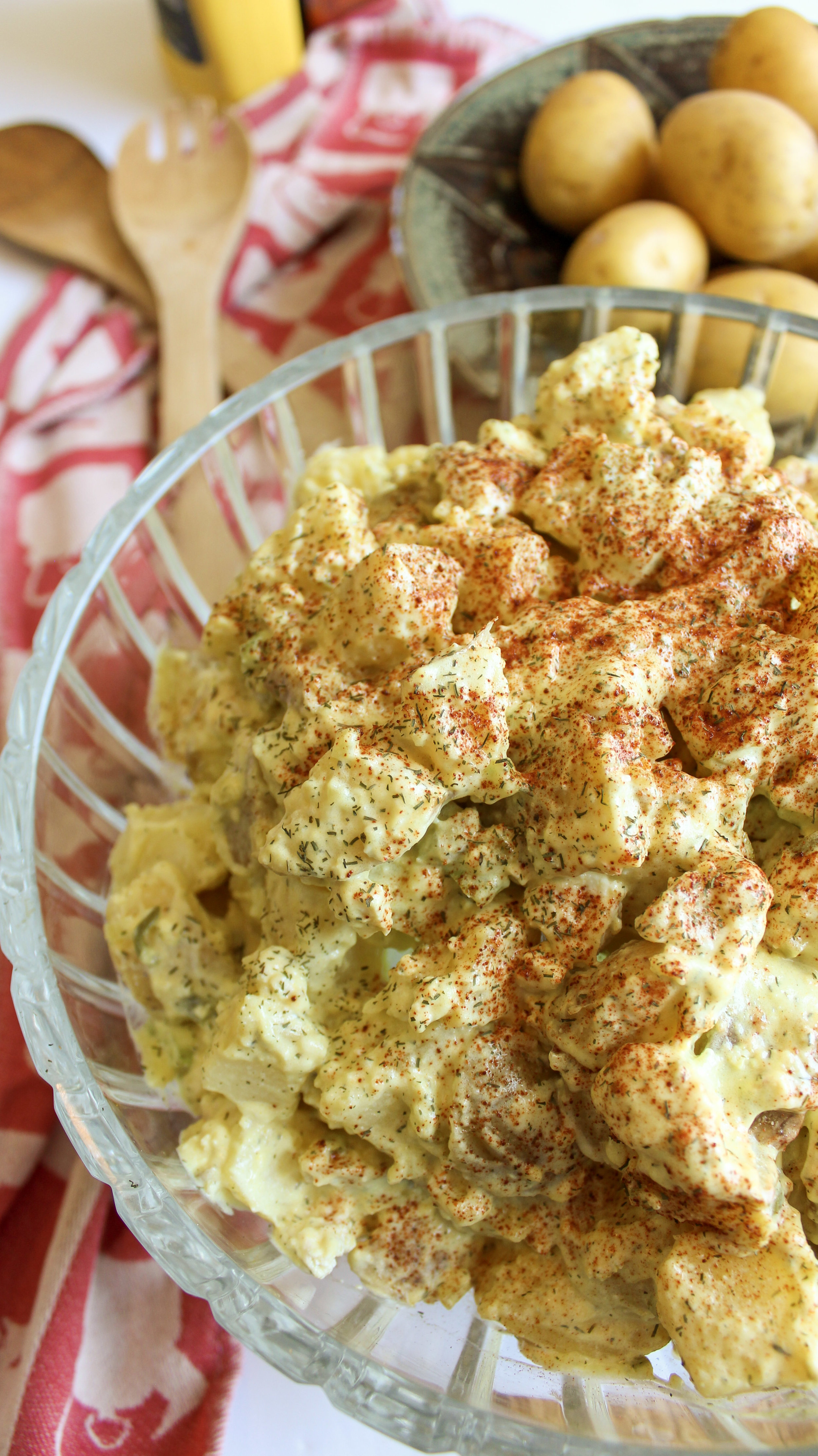 Panicking about what to bring to a BBQ as a vegan? Never fear! This super simple vegan potato salad is the perfect dish to bring and share. No one will even guess that it's vegan. Creamy, delicious and easy vegan potato salad. Vegan BBQ food. #bbq #potatosalad #veganbbq #veganpotatosalad www.musicandmunchiesblog.com