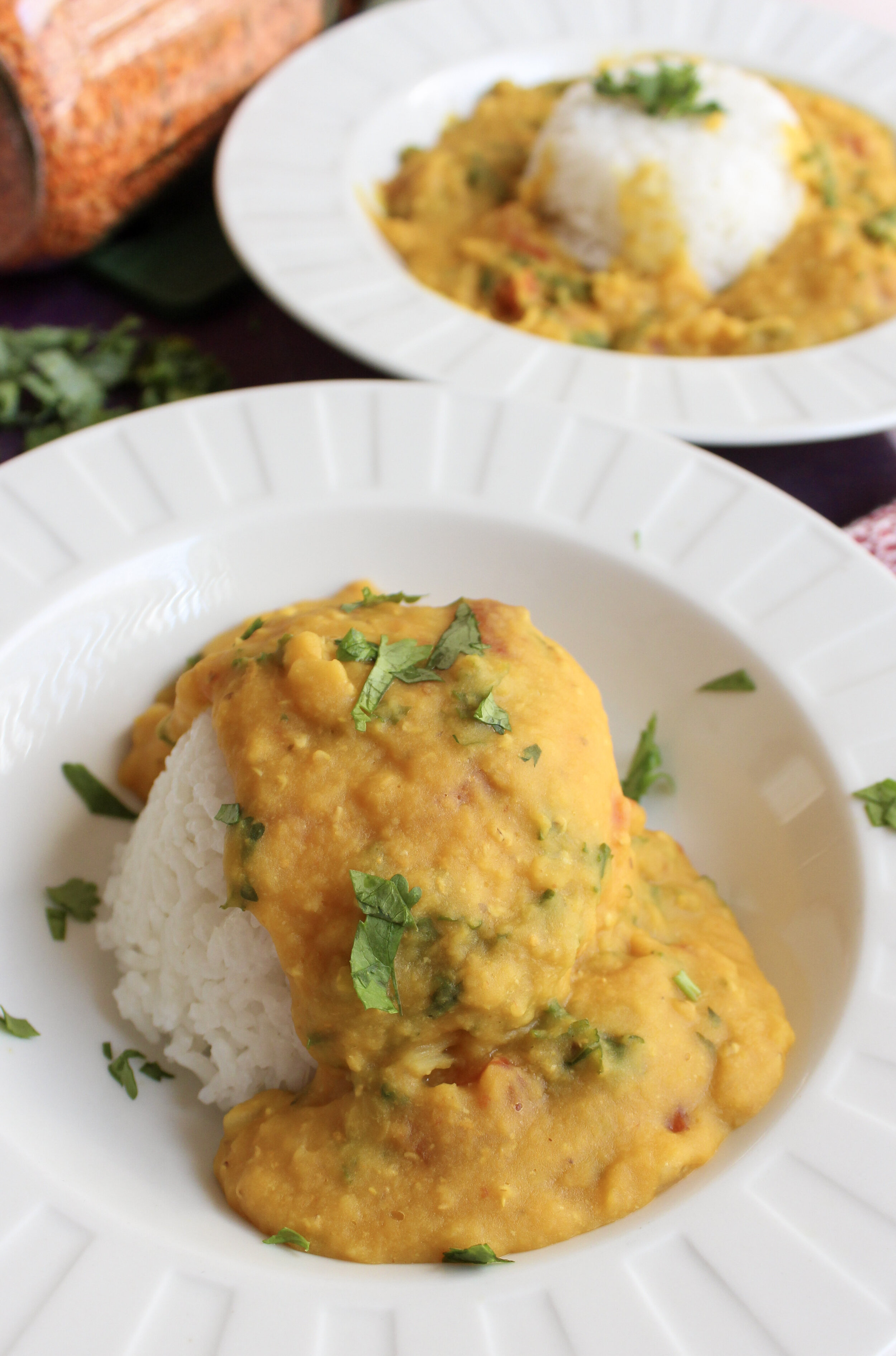 Creamy, satisfying and easy instant pot coconut red lentils. Perfect dish to make on a busy weeknight. Just chop, pour and cook all the ingredients in the instant pot. Full of protein and fiber. #glutenfree #dairyfree #vegan #hightprotein #instantpot #weeknightmeal #easyrecipe www.musicandmunchiesblog.com