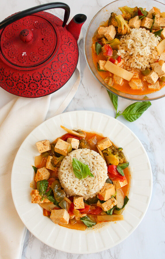 Vegan red Thai curry with tofu that is as close as you can get to Thai take-out. Bright, aromatic and absolutely delicious. Takes less than thirty minutes to make. Quick and east vegan Thai curry. Can be made gluten free. Dairy free. Fish Free. #vegancurry #thairecipe #veganthaicurry #thaicurry #redcurry #veganrecipe #quickandeasy www.DamnTastyVegan.com