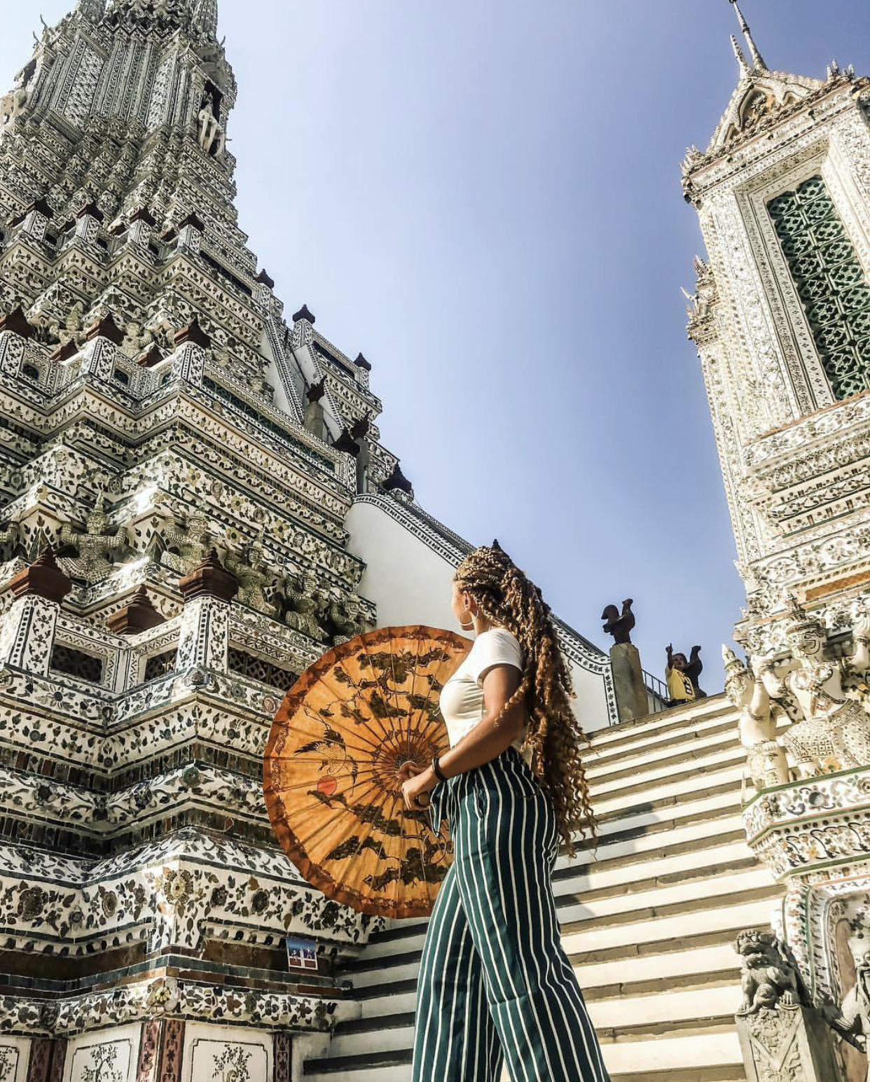 "Niya @ Wat Arun in Bangkok, Thailand - ''I travel for the culture. I travel for the history. I travel for the experience. I also travel for the amazing photo ops!"" IG:@ thebizzyboss"