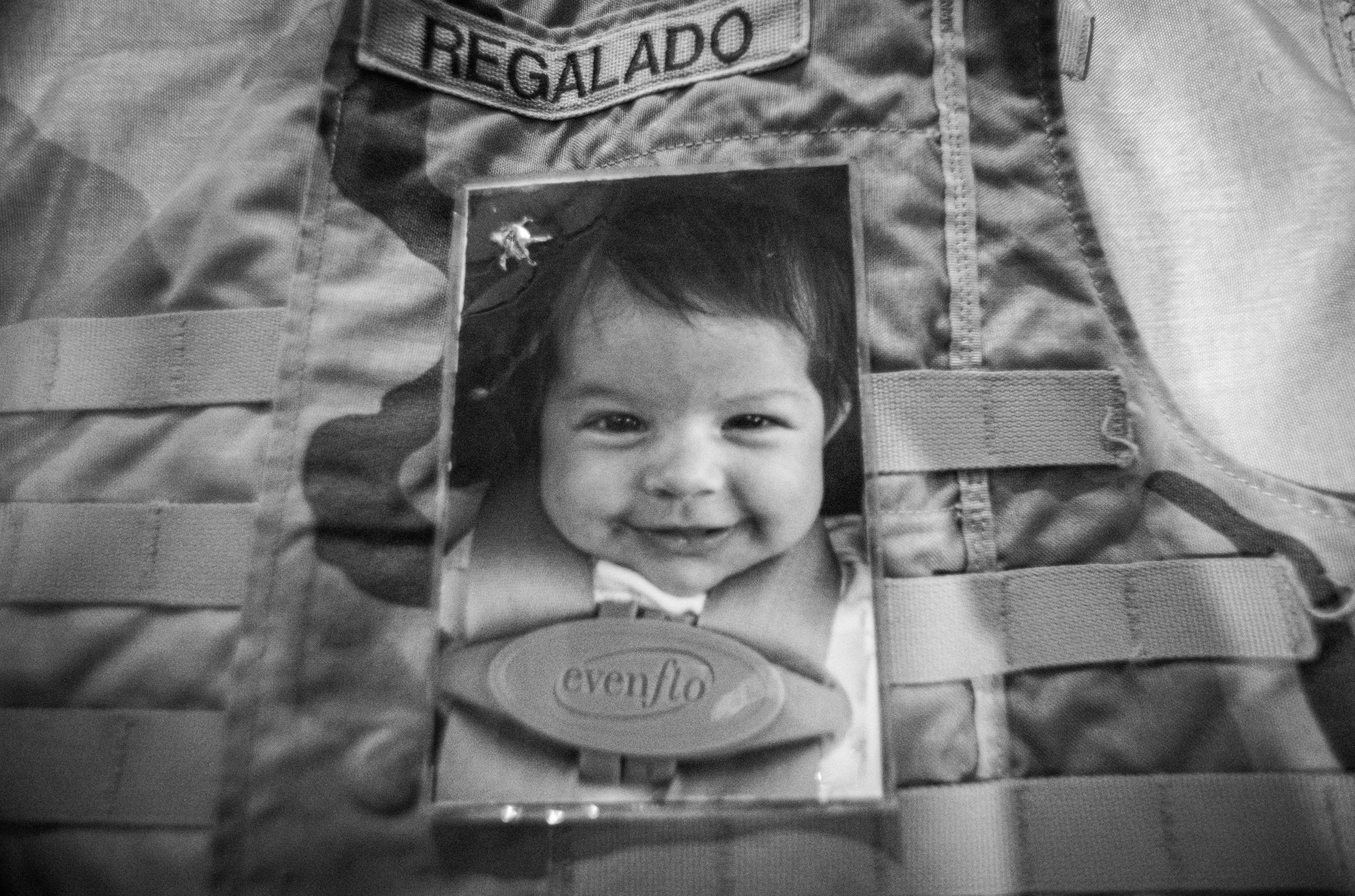 Josè was carrying this image of his daughter when he was killed. The upper left of the photo is where the bullet struck him, leaving him quickly incapacitated.