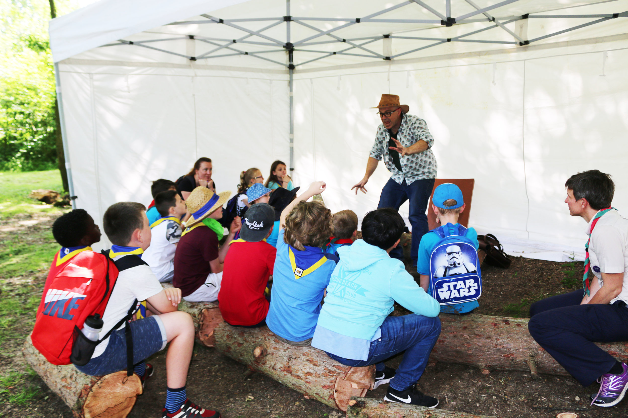 Outdoor storytelling at Frylands Wood Scout Activity Centre.
