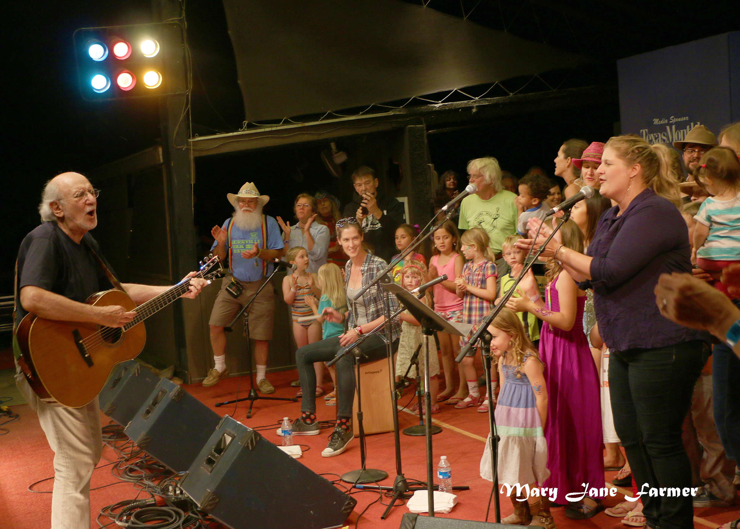 Peter Yarrow with friends on stage.jpg