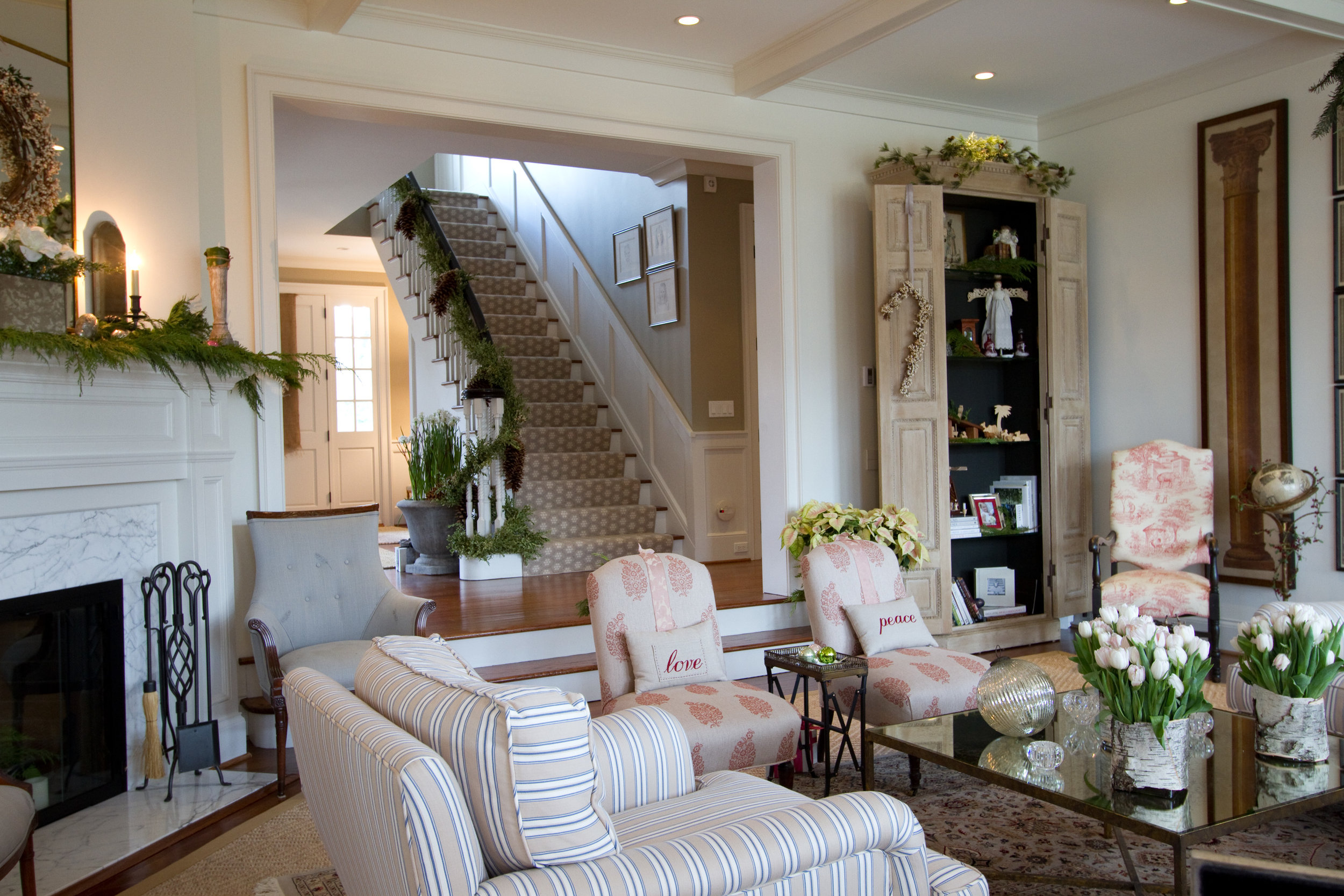 traditional living room interior with fireplace and staircase