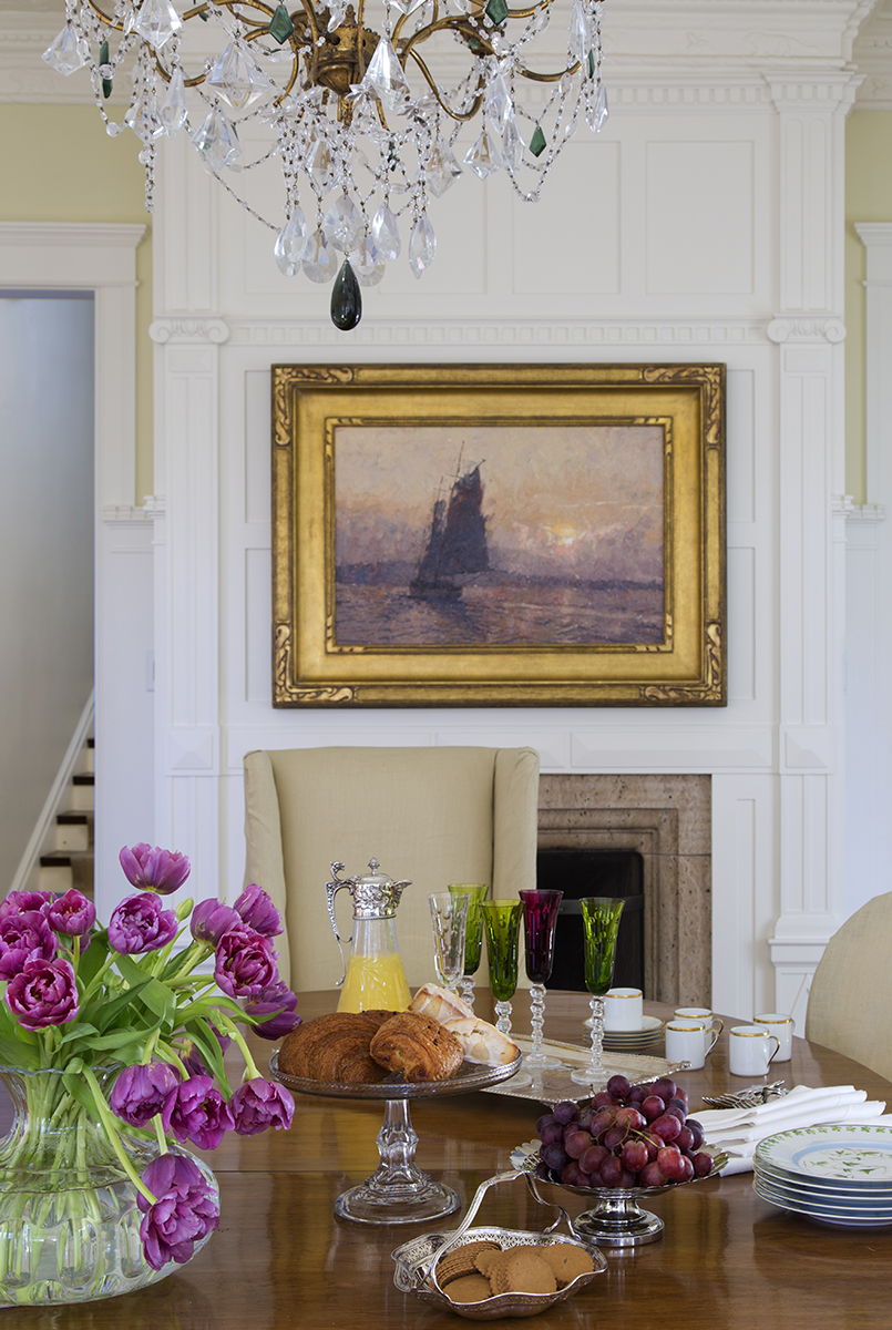 traditional interior design dining room with wall paneling and chandelier