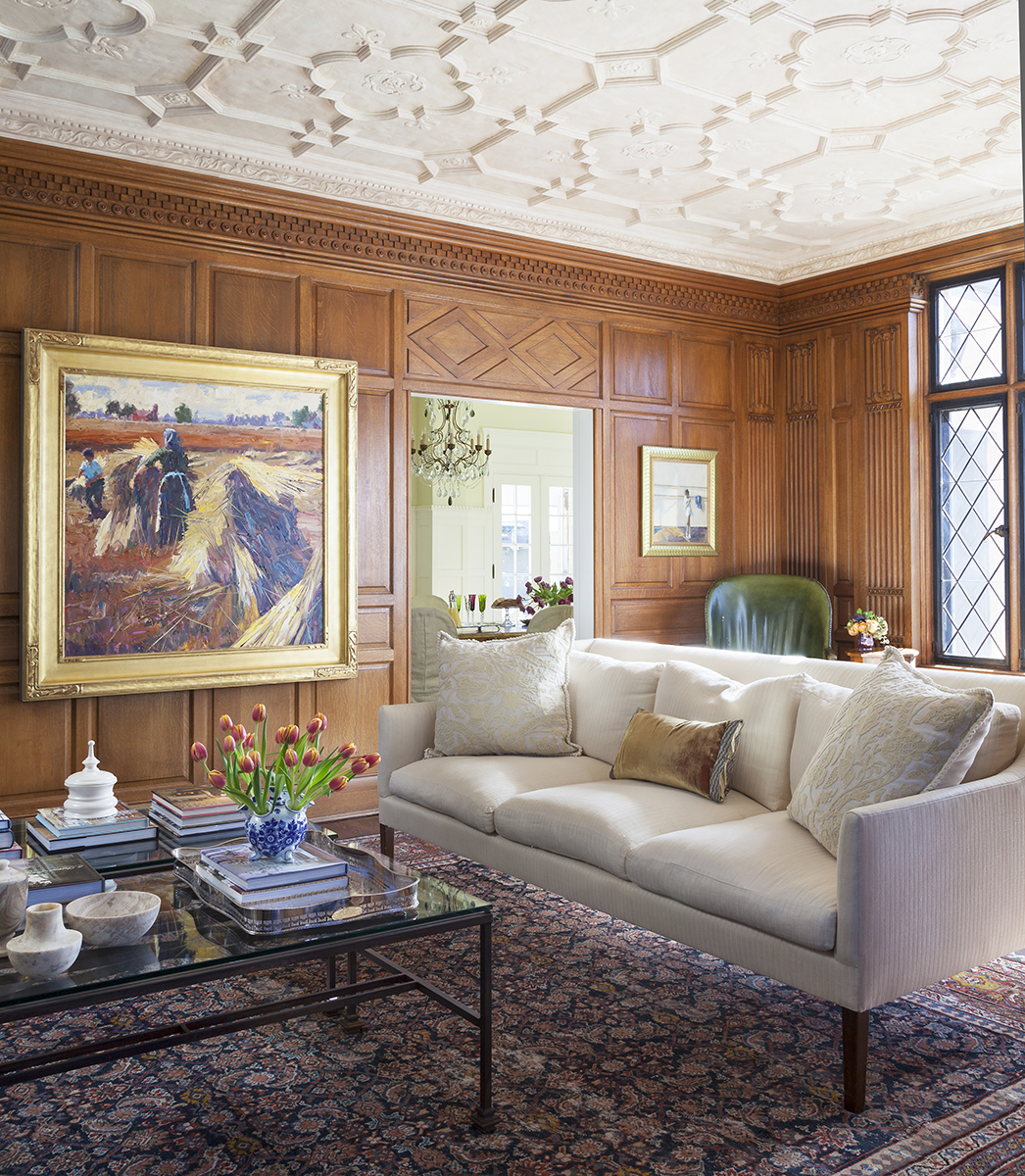 traditional interior design wall paneling with detailed plaster ceiling