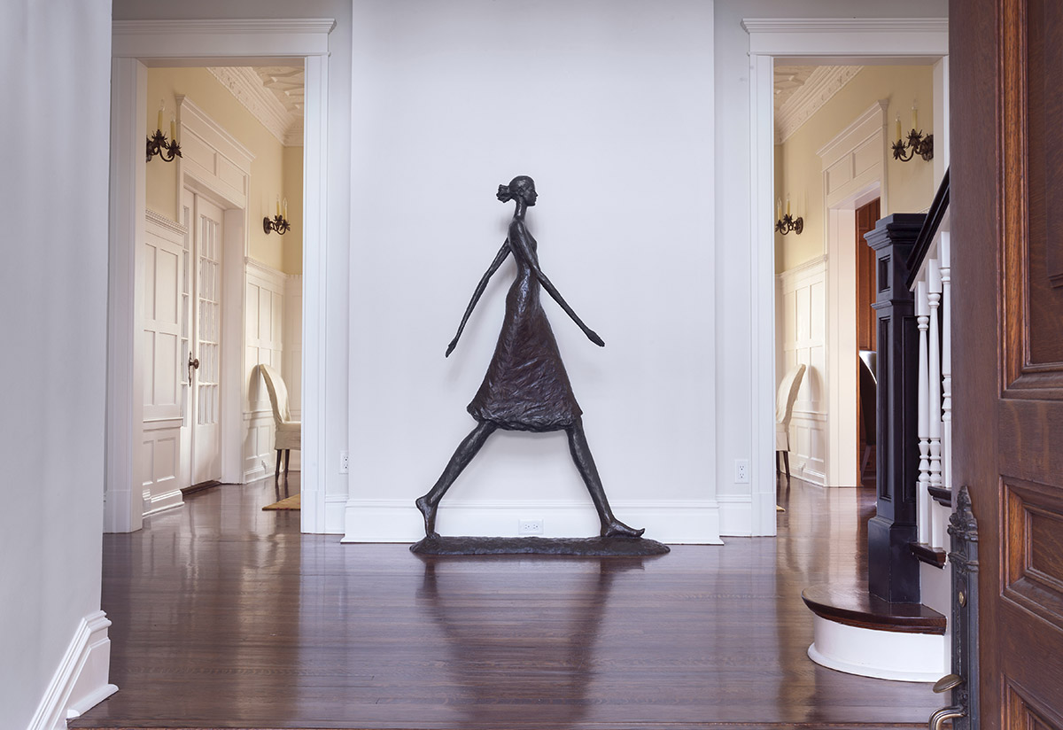 Entryway interior with woman bronze statue