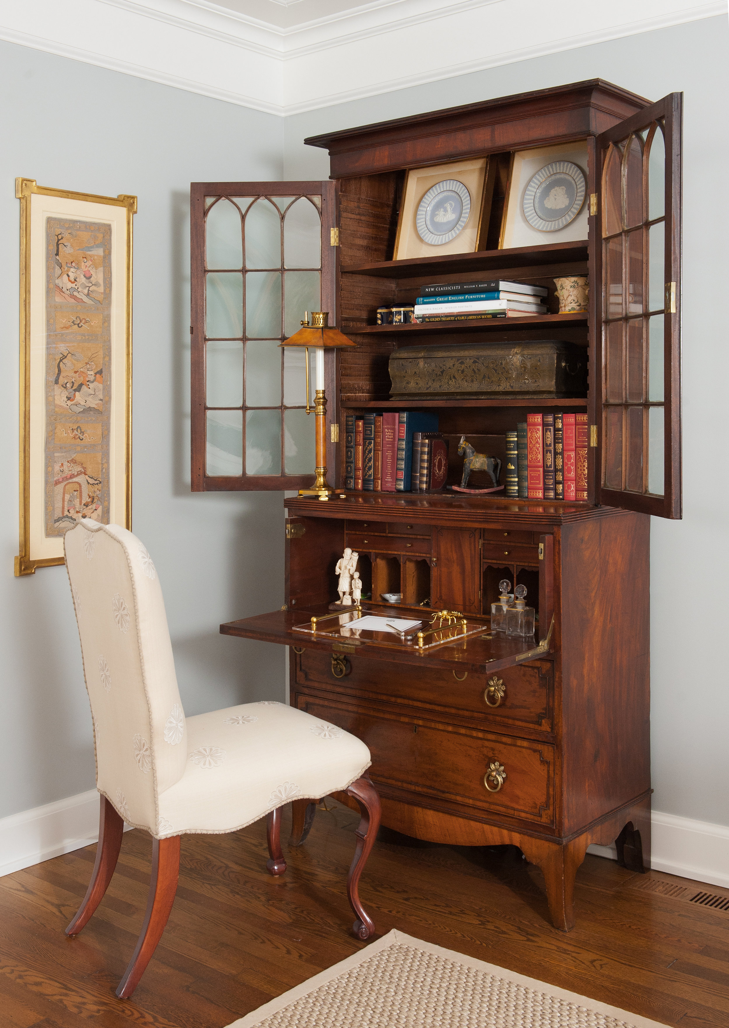 traditional interior design living room blue grey walls antique hutch desk