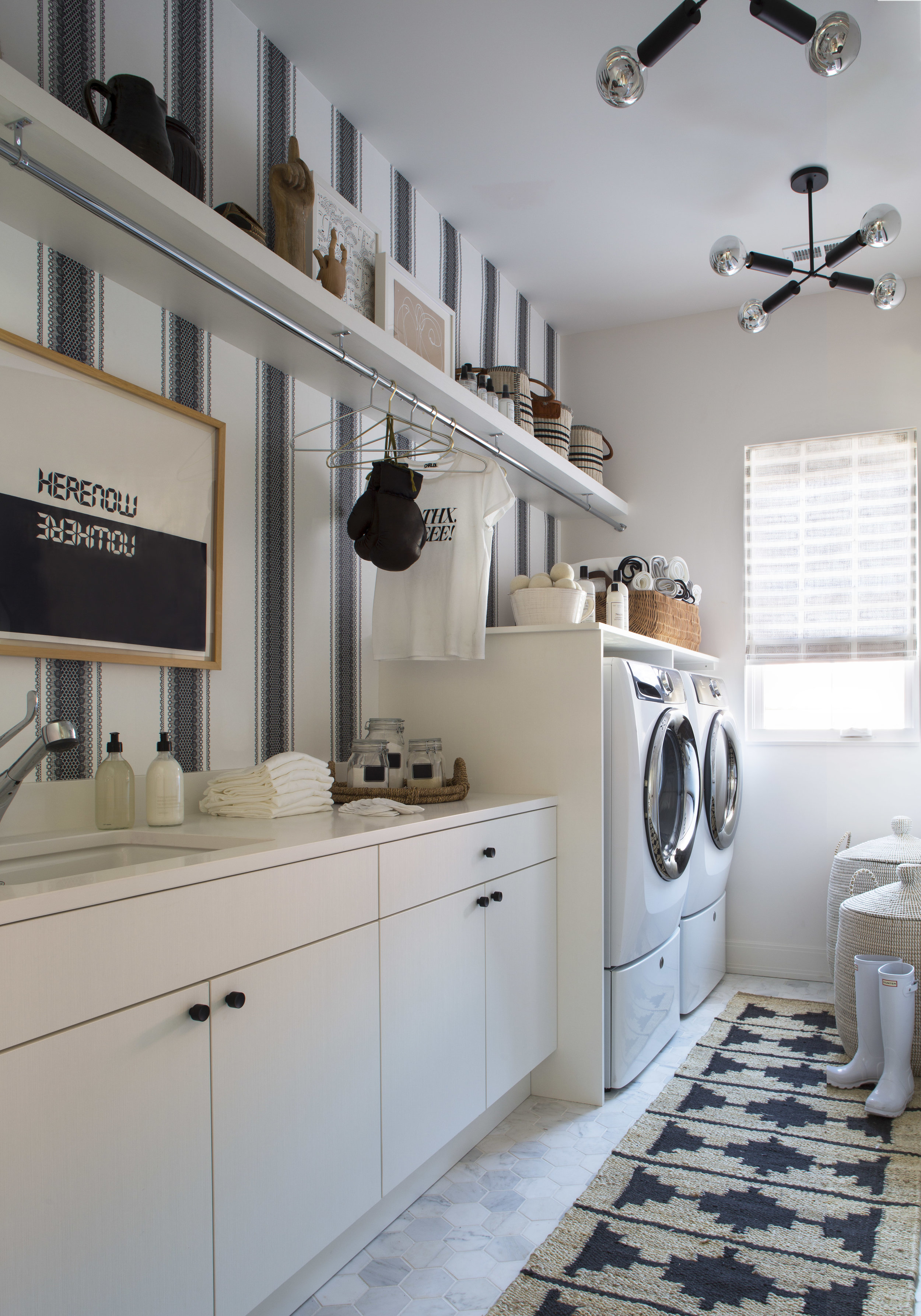 black and white striped laundry room