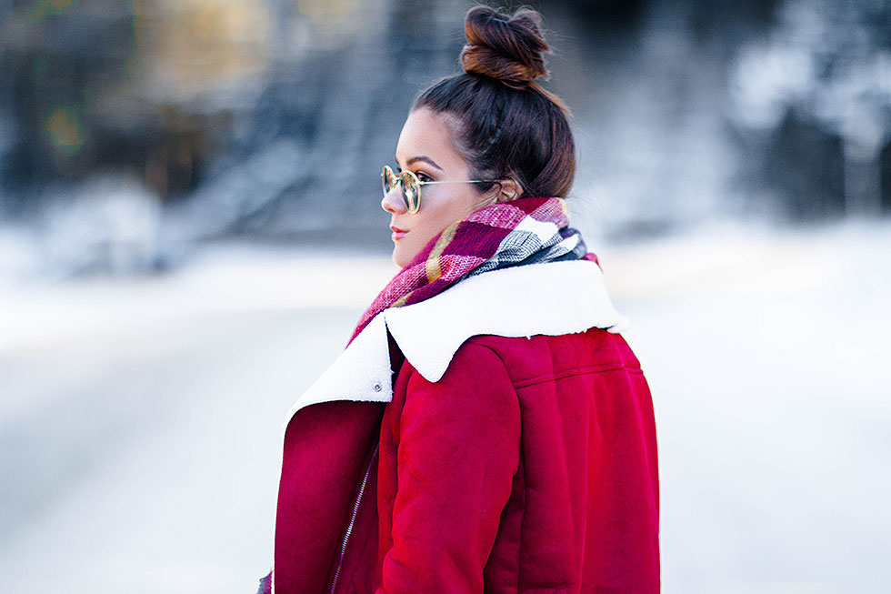 Festive Red Winter Outfit featuring Shearling Jacket and plaid scarf in Whistler Canada