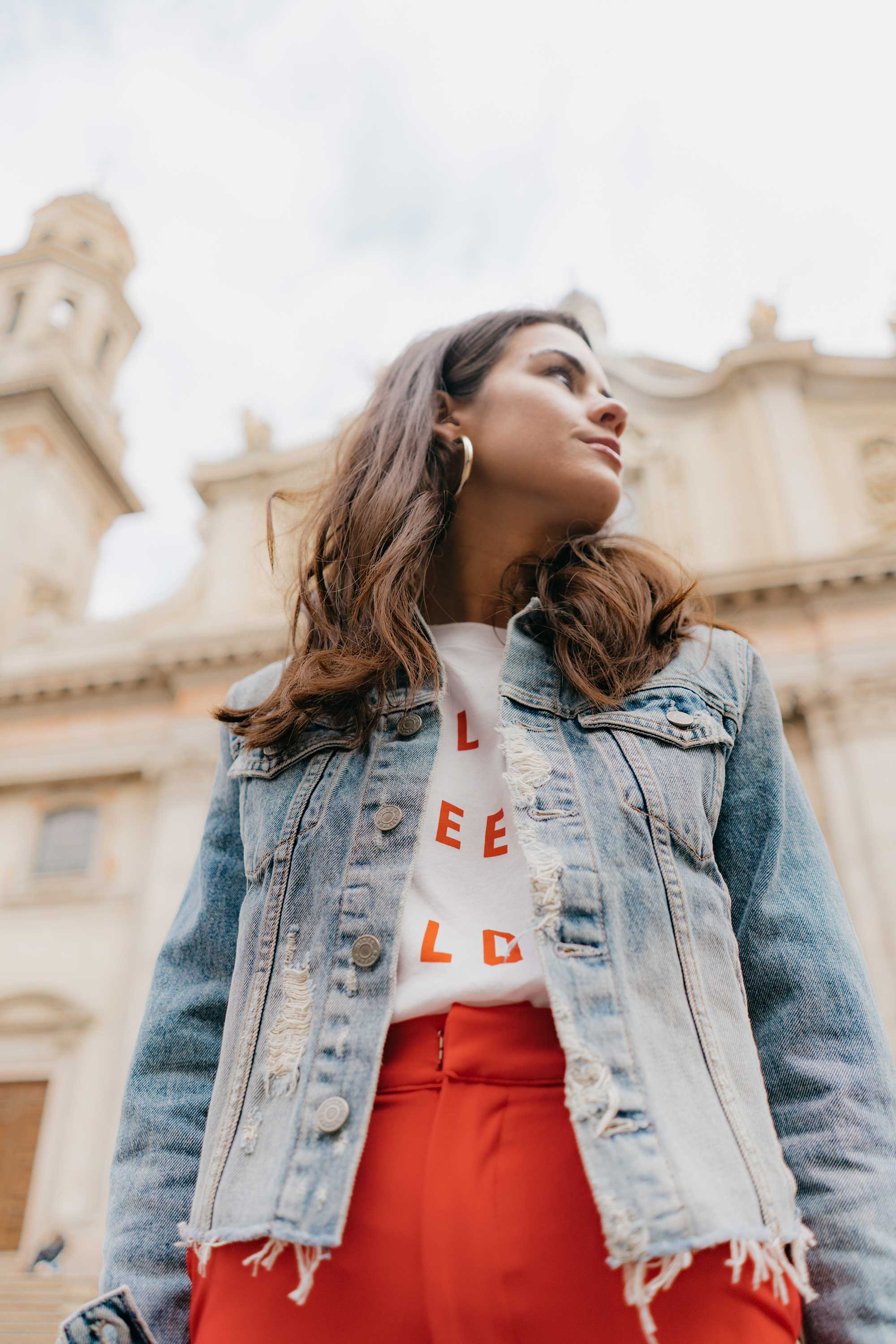 Red-Skinny-Pants,-All-You-Need-Is-Love'-Slogan-T-Shirt,-Cara-Cropped-Denim-Jacket,-Milan-Spring-Outfit8.jpg
