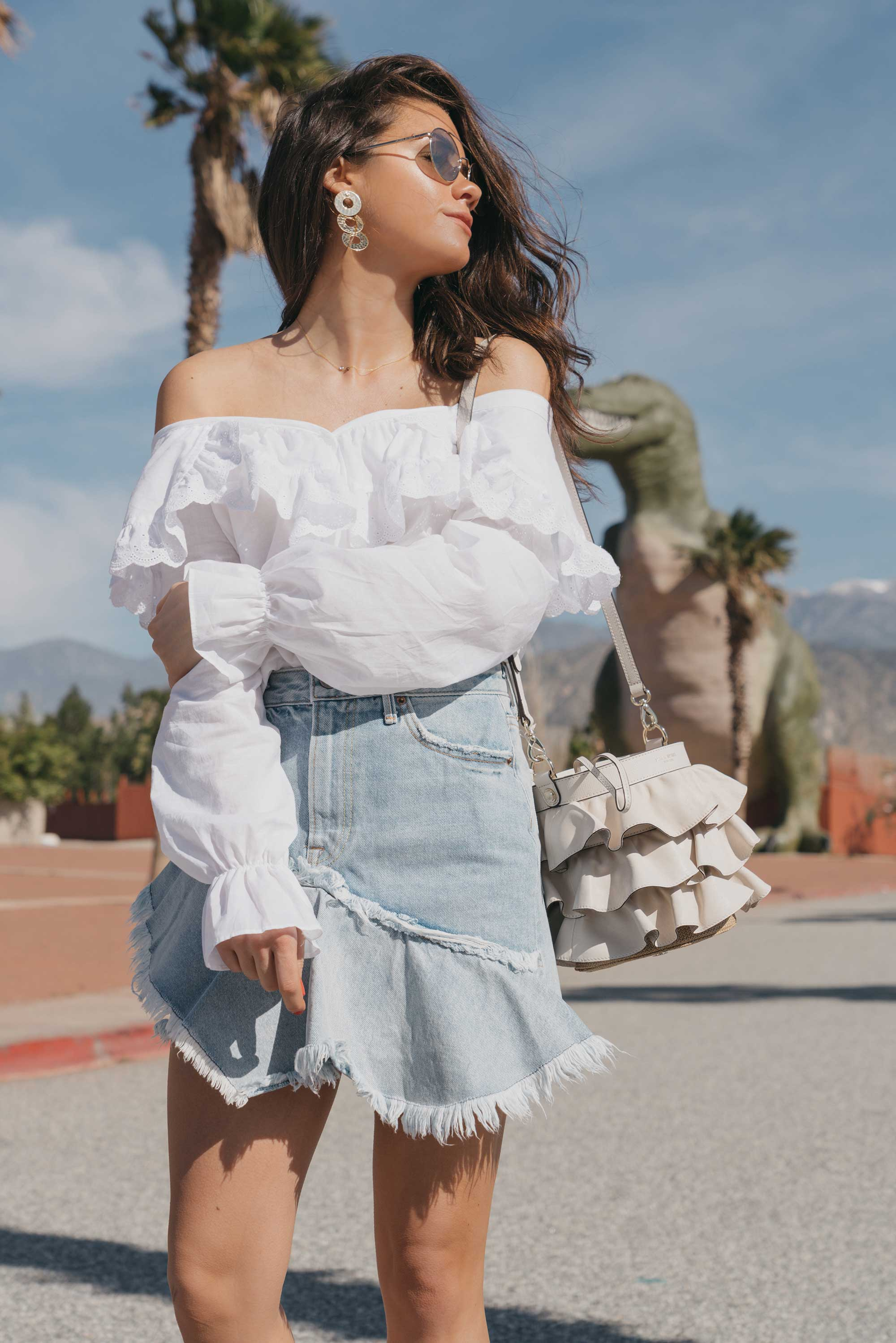 Festival-outfit-off-the-shoulder-ruffle-blouse-ruffle-denim-skirt-cabazon-dinosaurs7.jpg