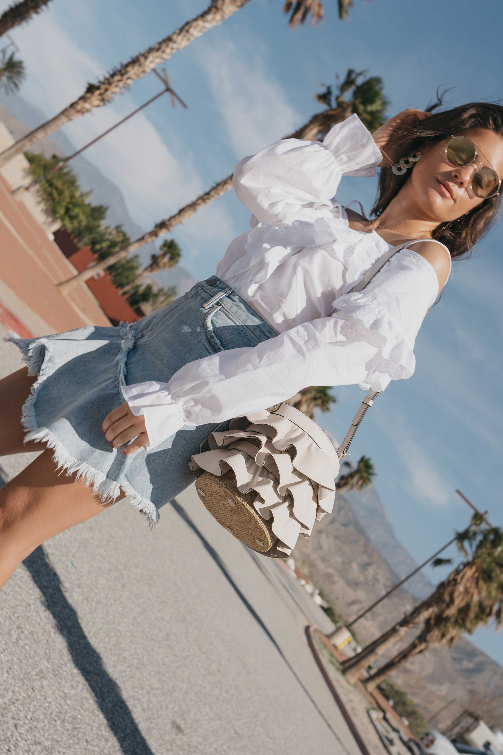 Festival-outfit-off-the-shoulder-ruffle-blouse-ruffle-denim-skirt-cabazon-dinosaurs4.jpg