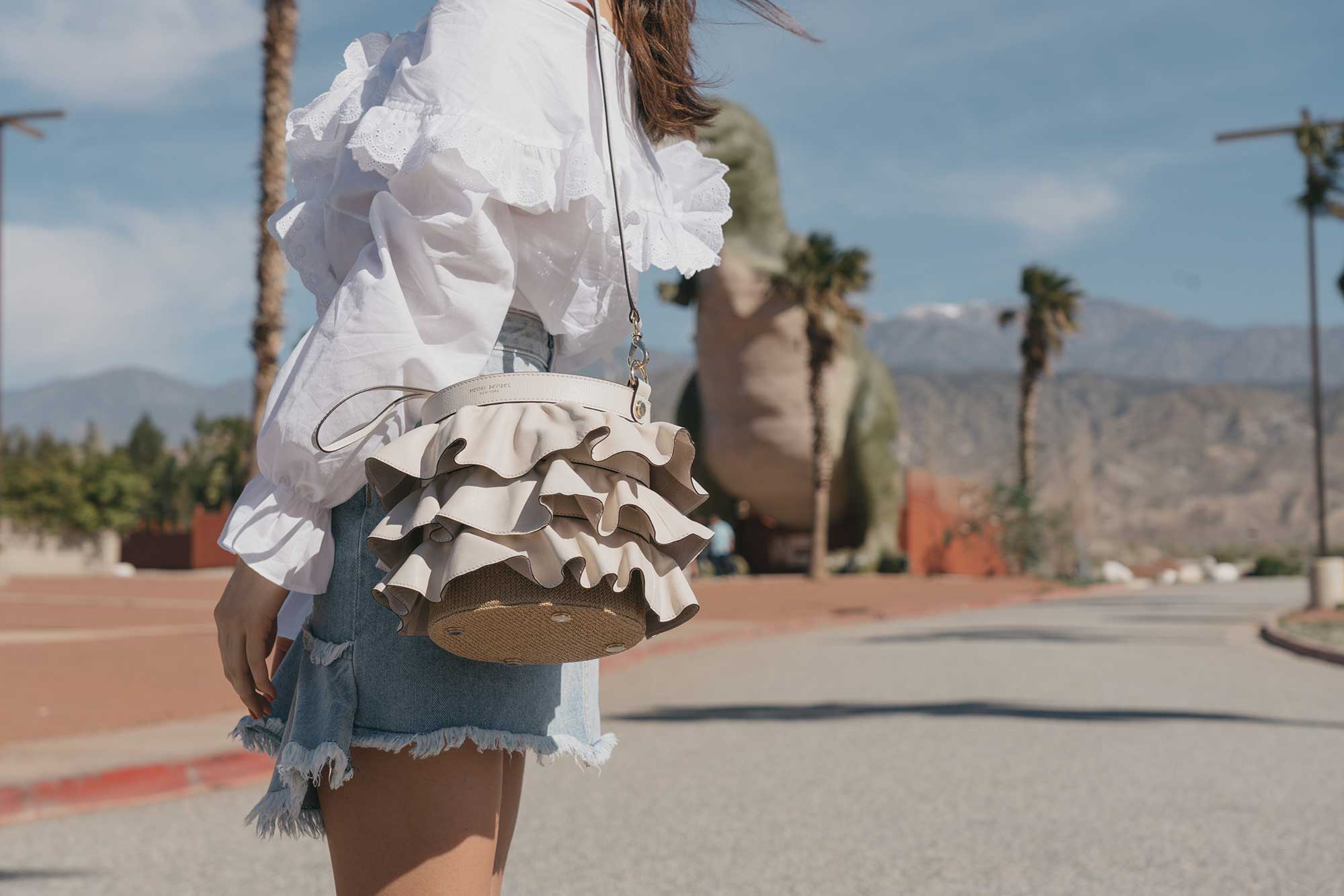 Festival-outfit-off-the-shoulder-ruffle-blouse-ruffle-denim-skirt-cabazon-dinosaurs2.jpg