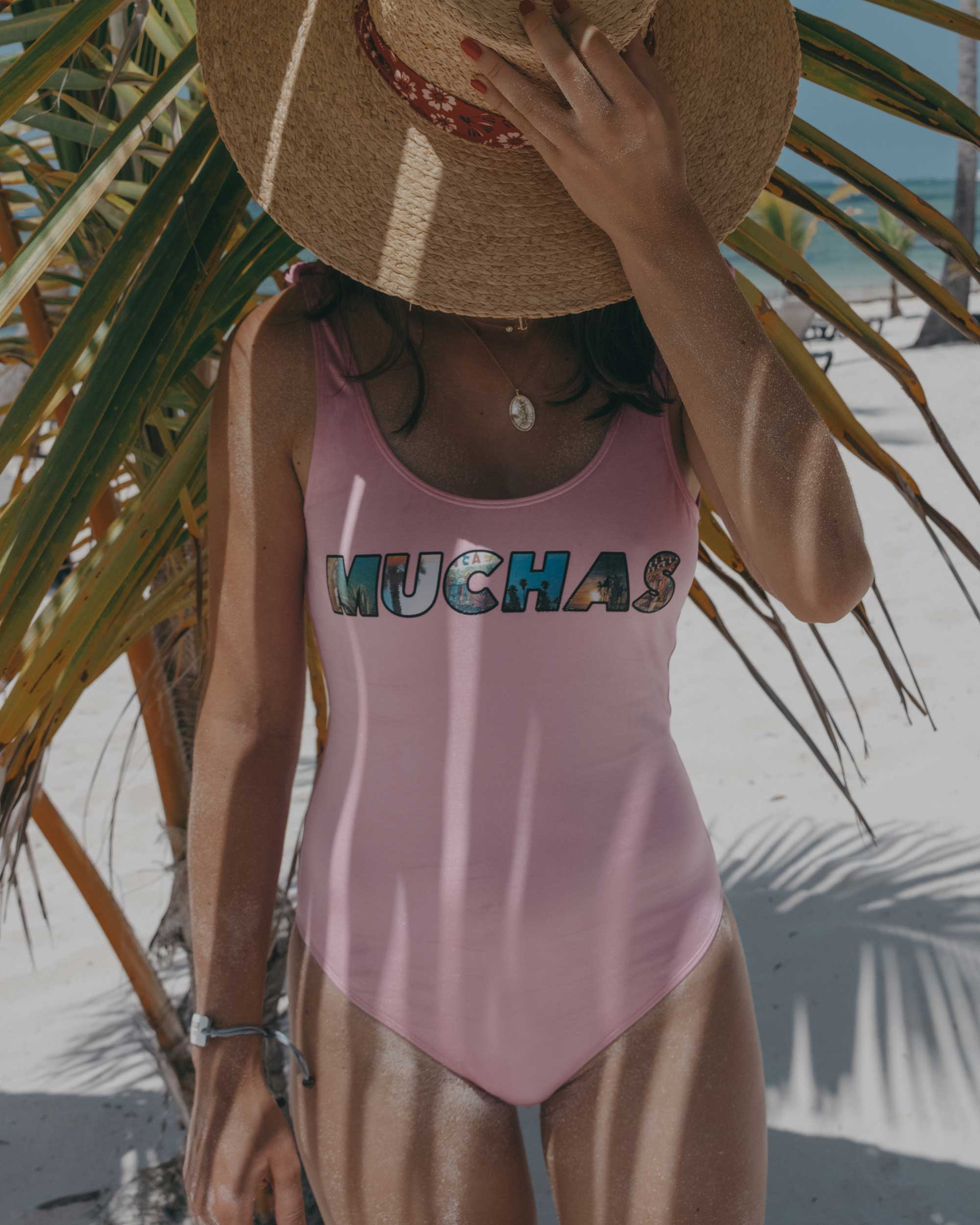 pink one piece swimsuit reading muchas dominican republic beach outfit7.jpg