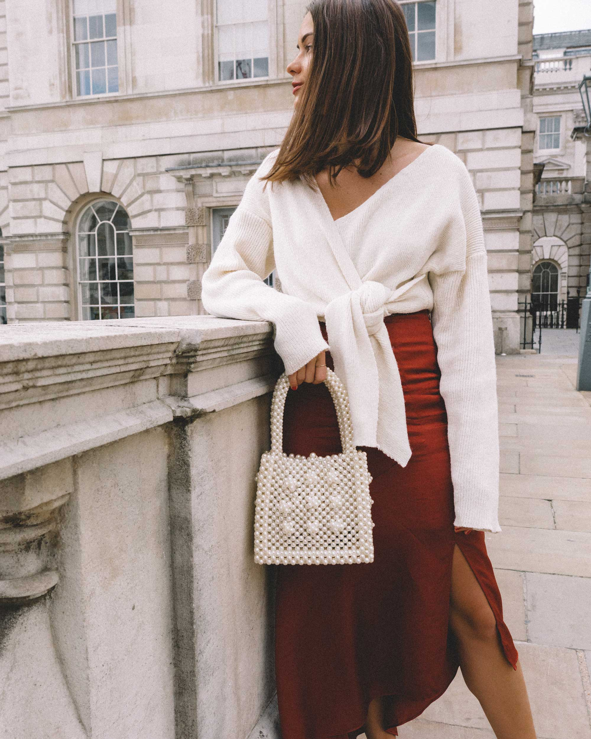 & Other Stories Asymmetric Slit Midi Skirt, Faux Pearl Handbag, Tied knot front Sweater london streetstyle outfit3.jpg