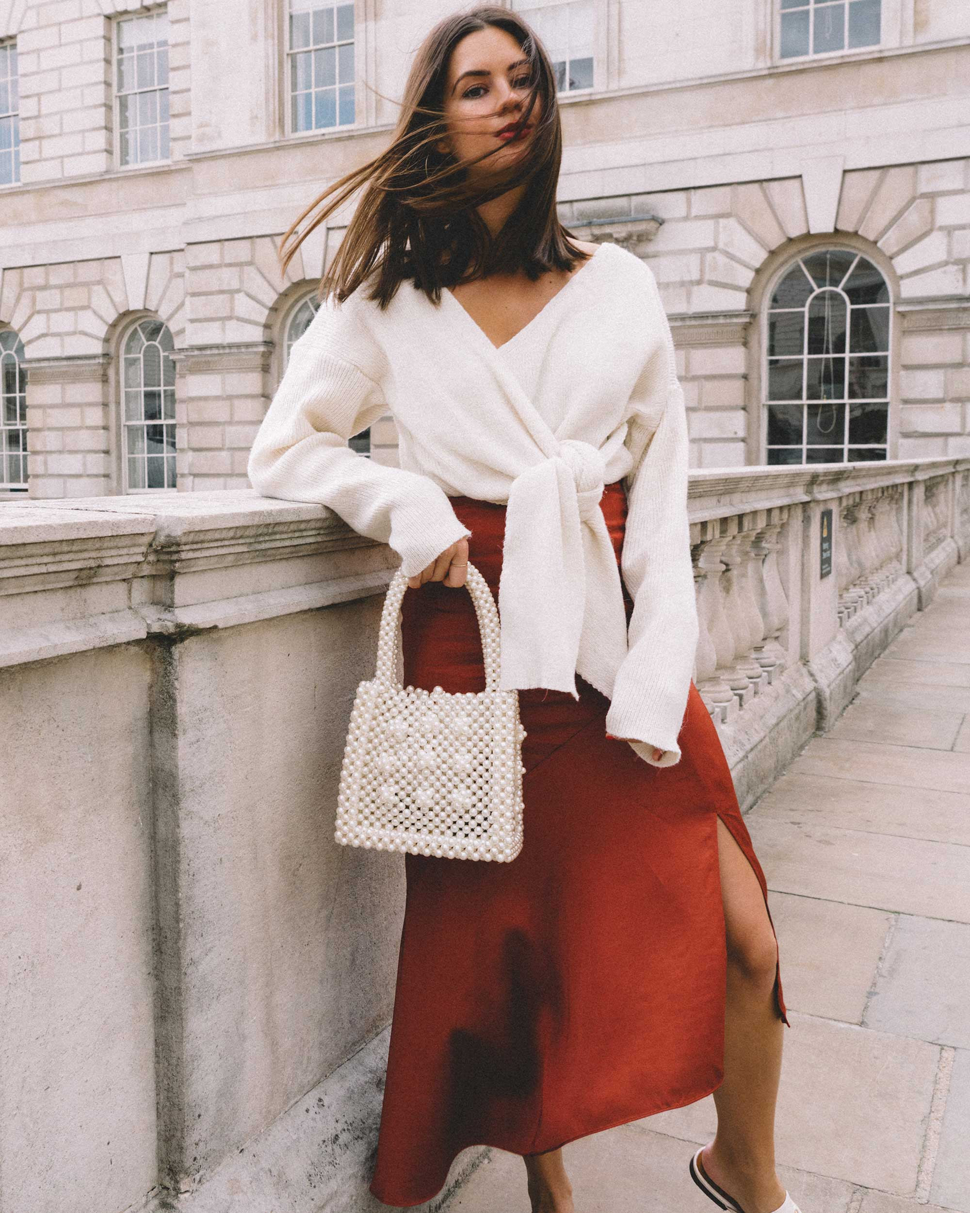 & Other Stories Asymmetric Slit Midi Skirt, Faux Pearl Handbag, Tied knot front Sweater london streetstyle outfit2.jpg