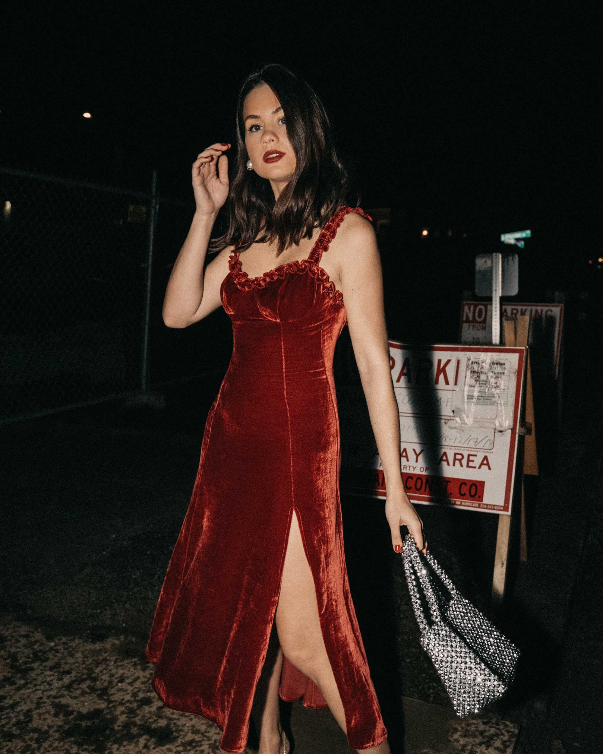 Reformation Pyrenees red velvet midi length dress with a ruffle neckline, and a side slit holiday outfit3.jpg