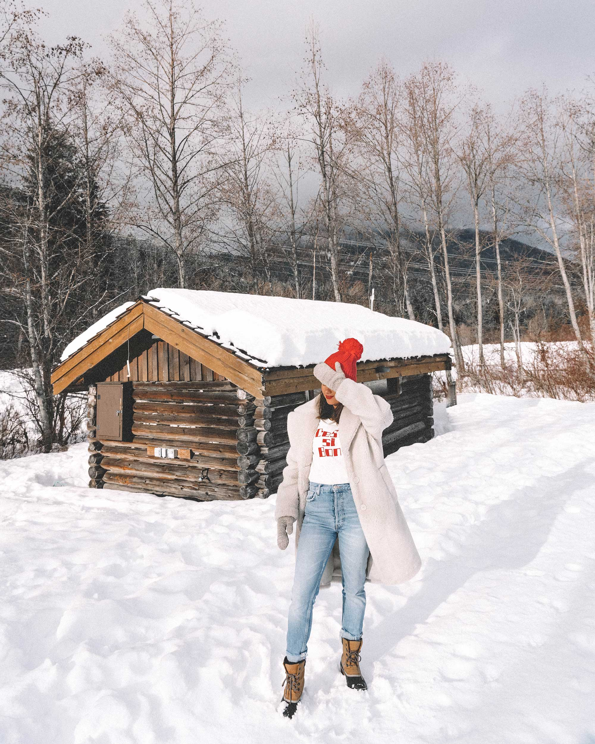 Winter snow outfit white faux shearling coat and sorel boots with jeans whislter canada5.jpg