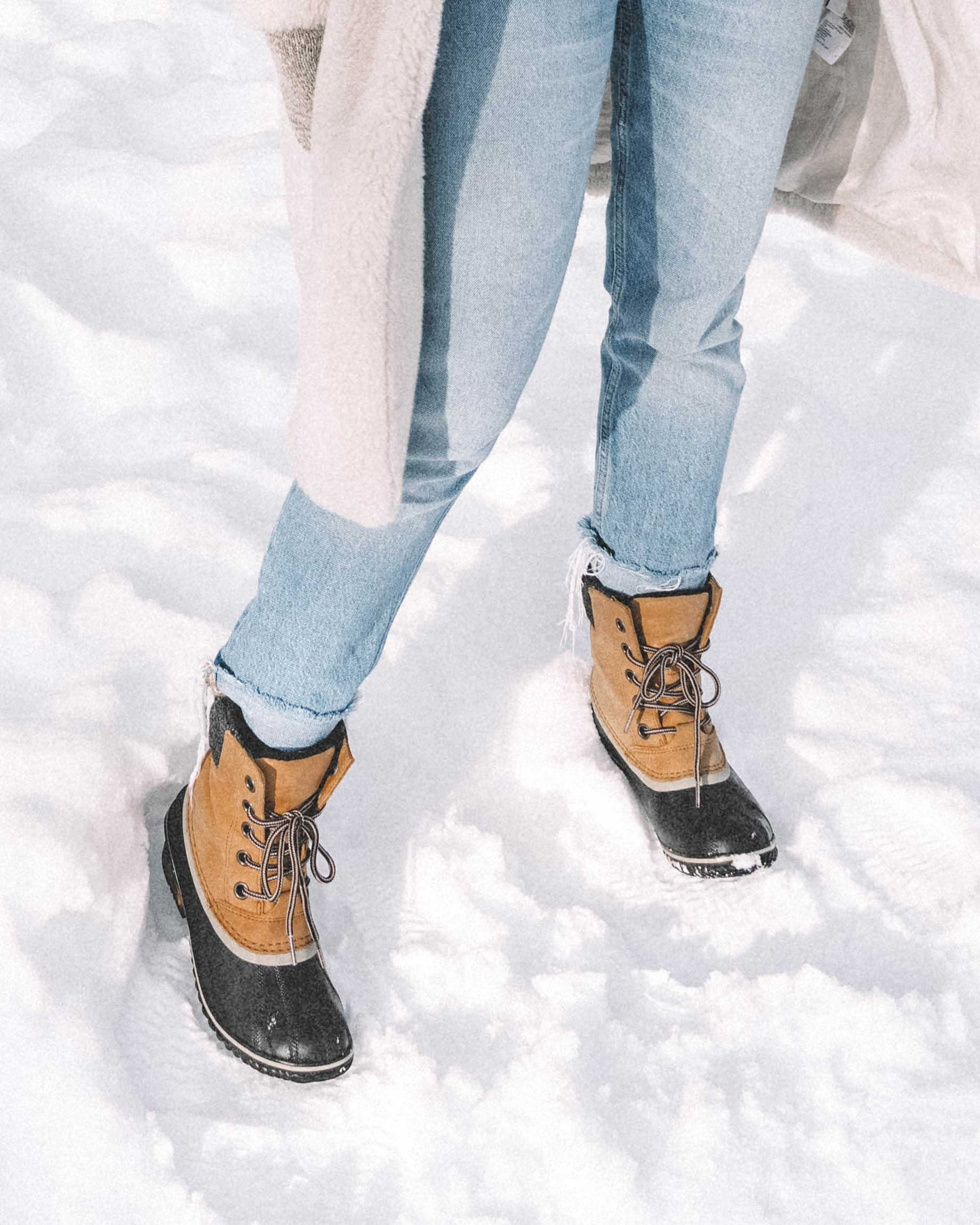 Winter snow outfit white faux shearling coat and sorel boots with jeans whislter canada13.jpg