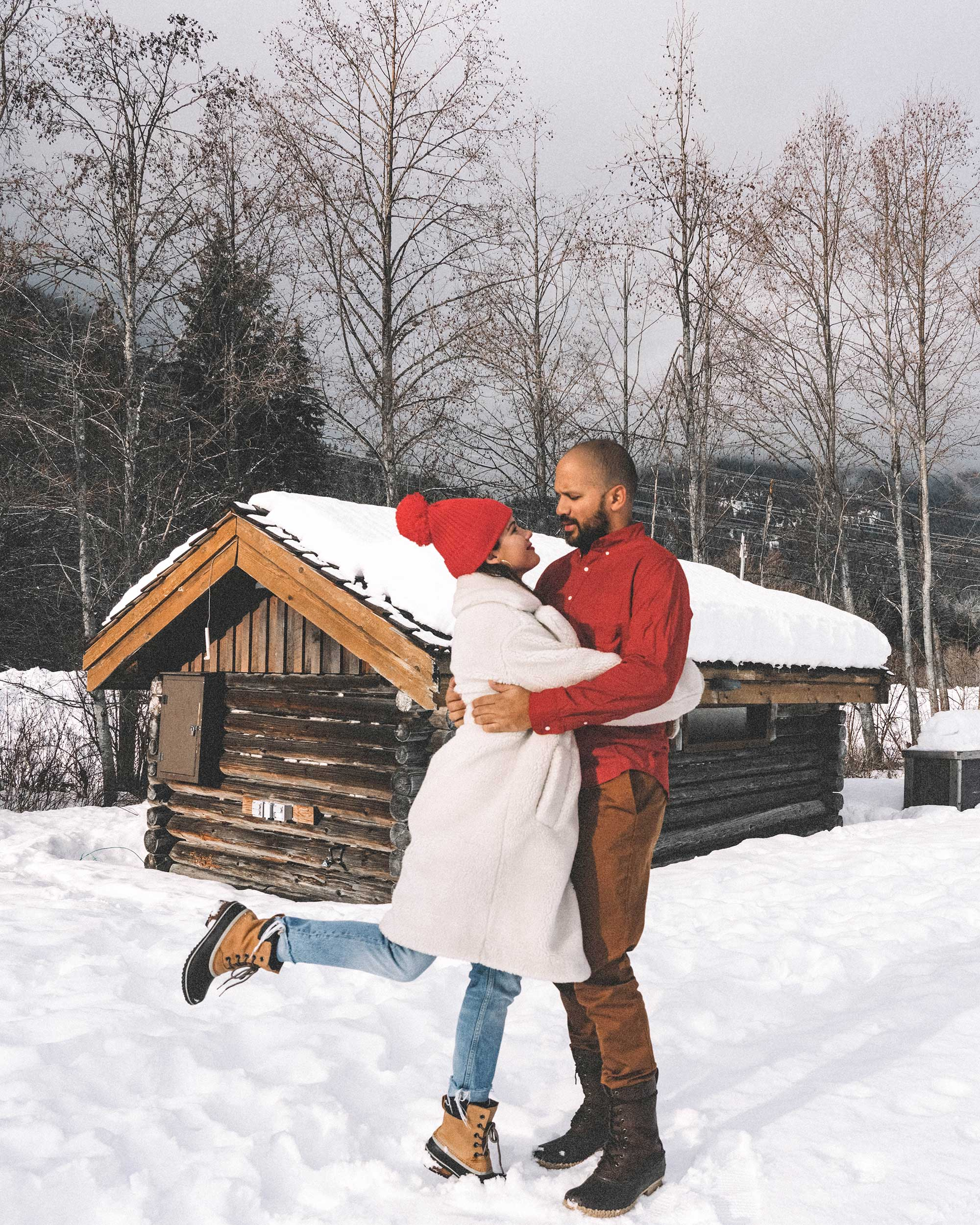 couples Winter snow outfit white faux shearling coat and sorel boots with jeans whislter canada.jpg