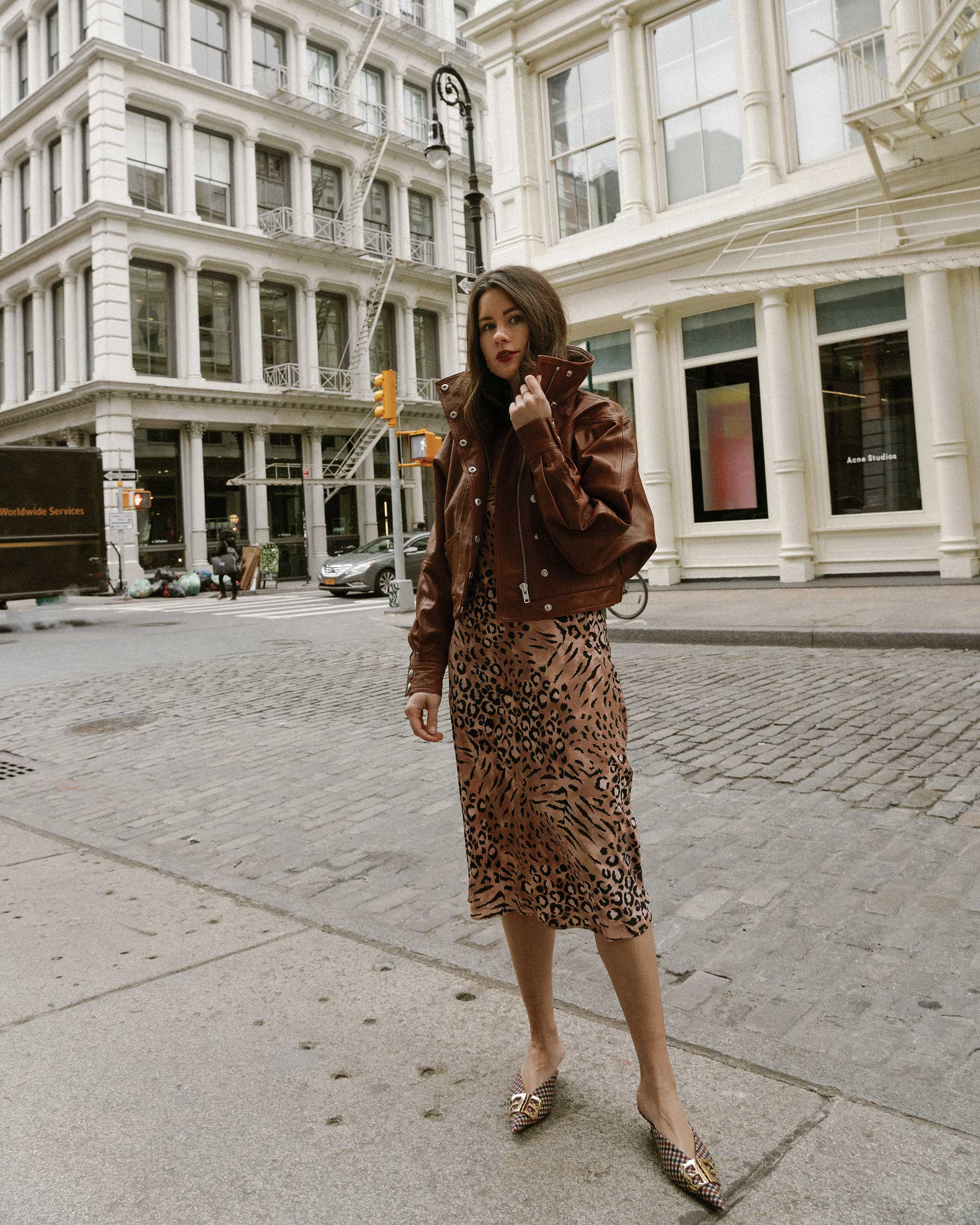 Sarah Butler of Sarah Styles Seattle wears PAIGE Cicely animal print slip dress and Revolve LPA oversized brown leather bomber jacket in Soho, New York | @sarahchristine, Seattle Blogger7.jpg