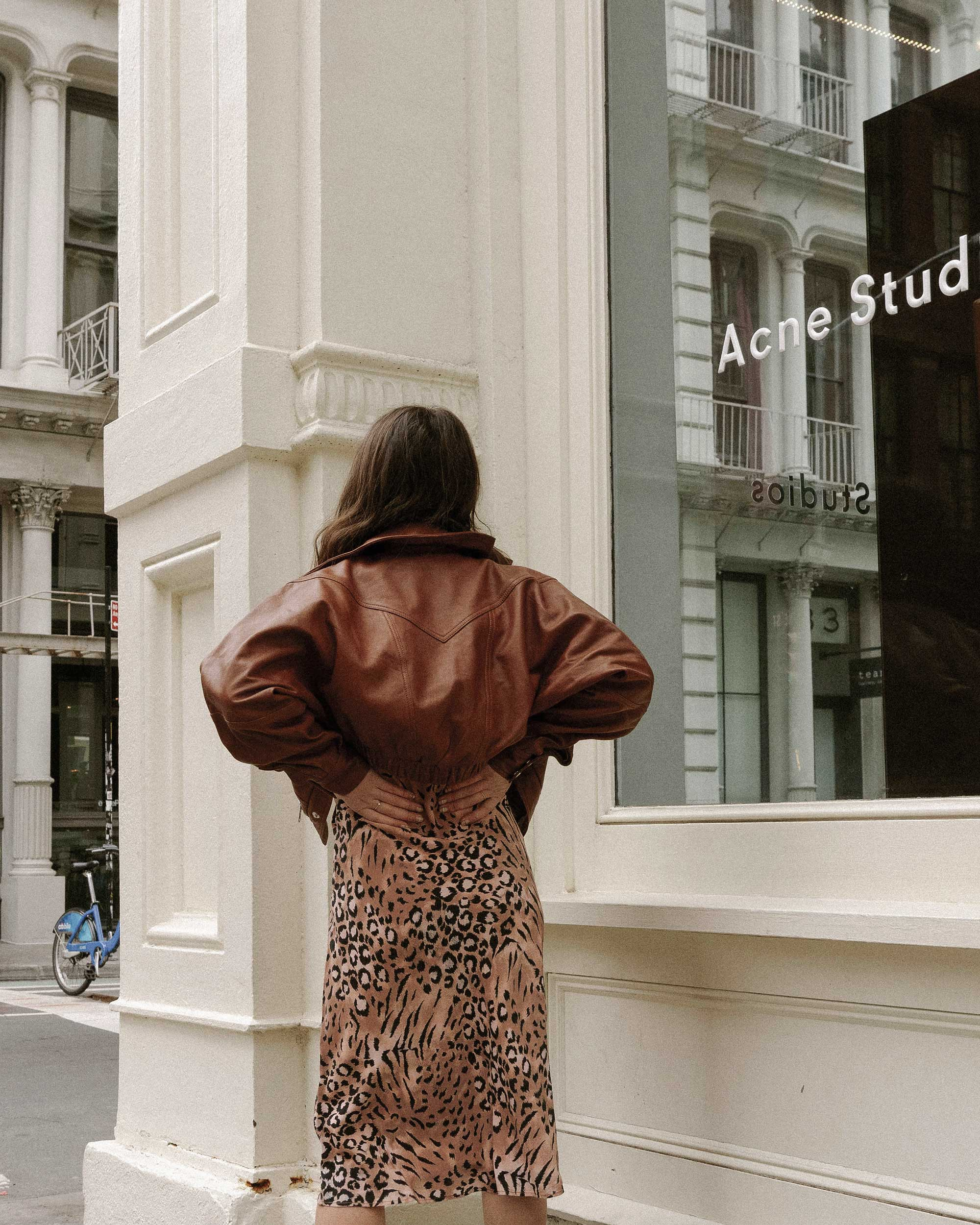 Sarah Butler of Sarah Styles Seattle wears PAIGE Cicely animal print slip dress and Revolve LPA oversized brown leather bomber jacket in Soho, New York | @sarahchristine, Seattle Blogger2.jpg