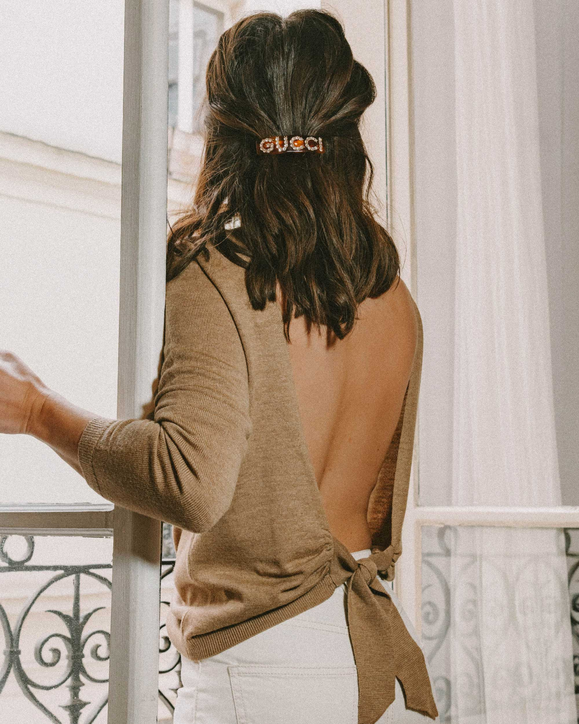Mornings in Paris - Sezane backless sweater and crystal Gucci single hair barrette in Paris, France.