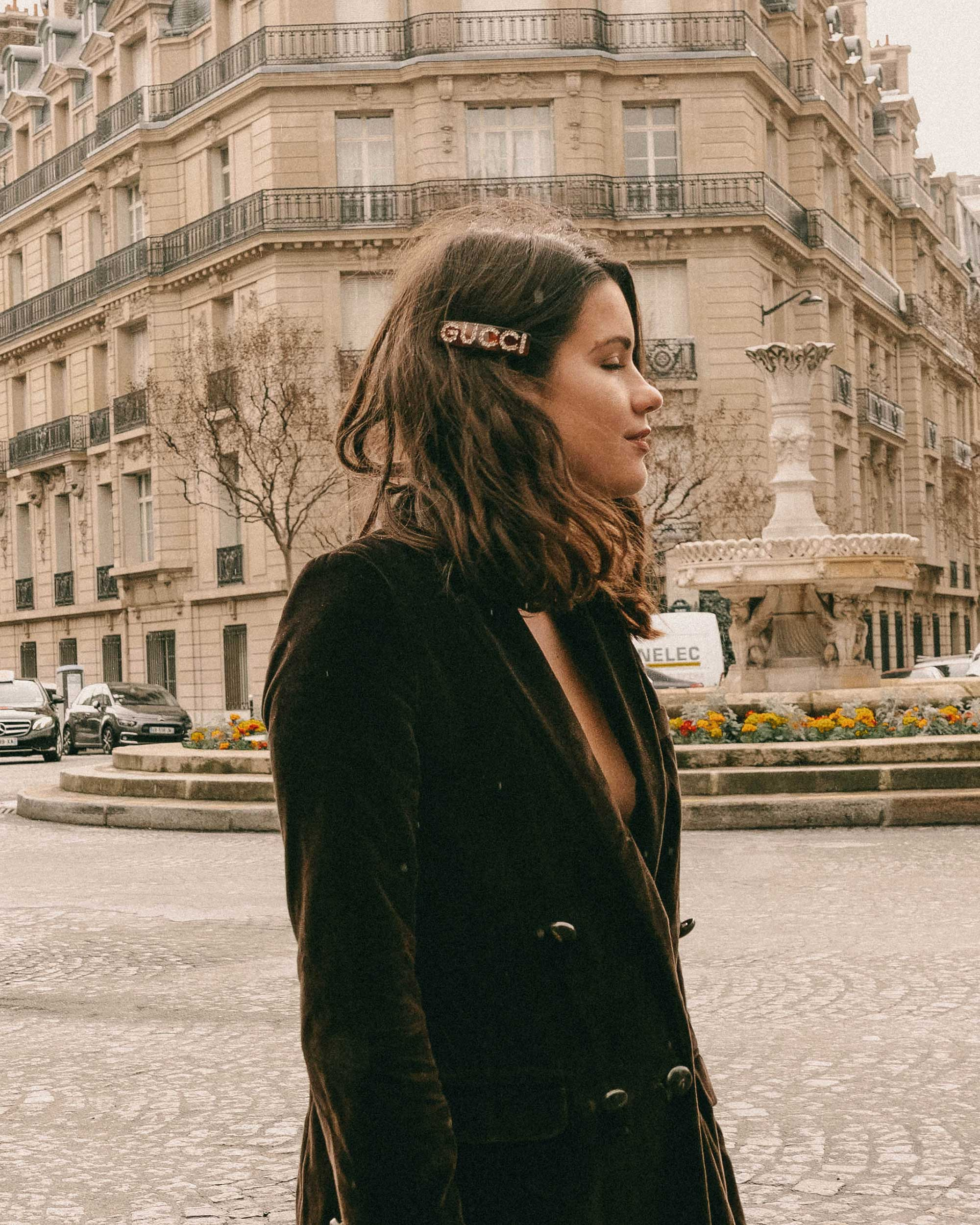 Parisian Girl - Sezane Christie brown velvet blazer with tights and crystal Gucci single hair barrette in Paris, France.