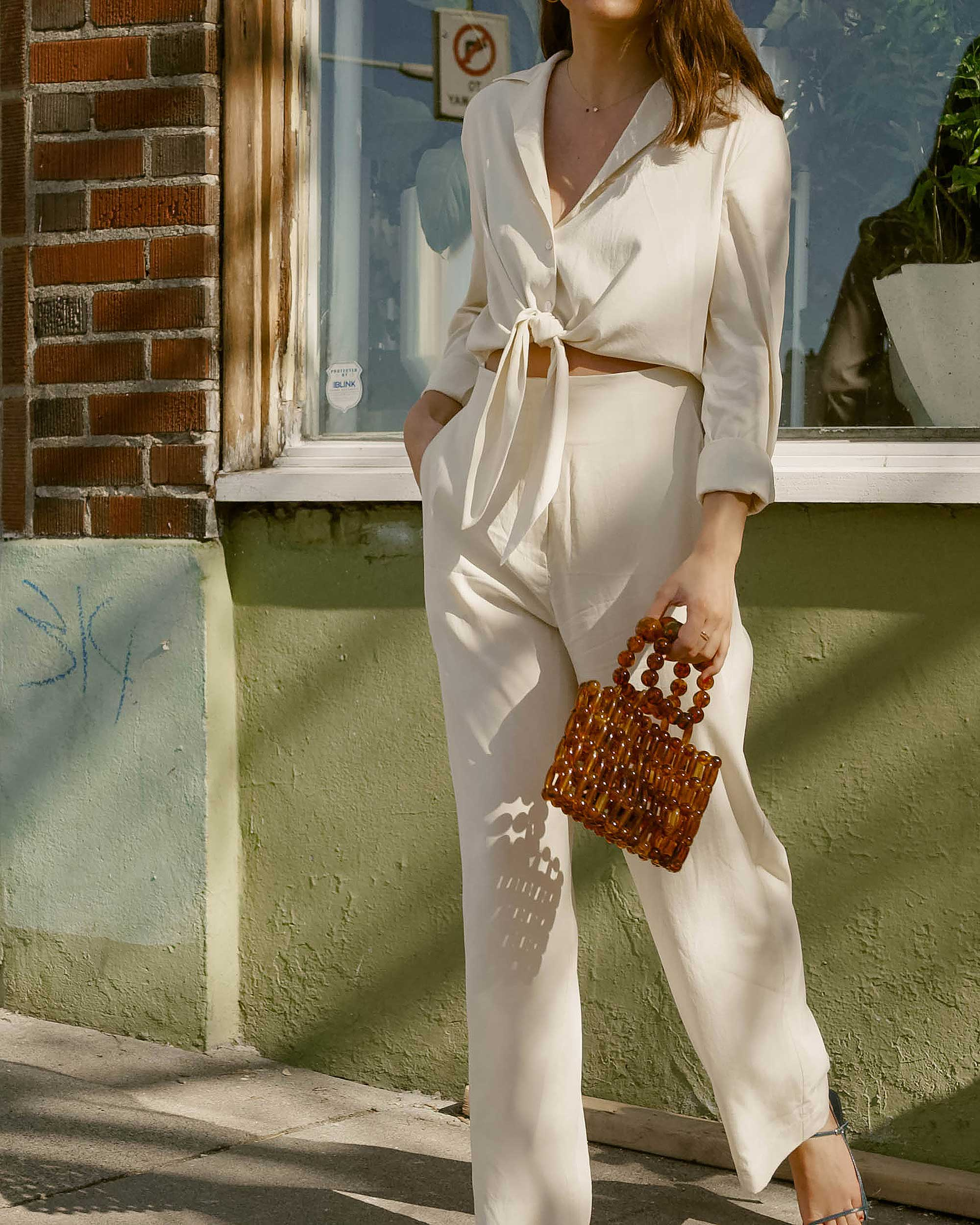 Sarah Butler of Sarah Styles Seattle wears Nanushka Long sleeve Tanya Tie-Front Jumpsuit and Cult Gaia Acrylic Cora Clutch in tortoise shell brown in Seattle | @sarahchristine, Seattle Blogger5.jpg