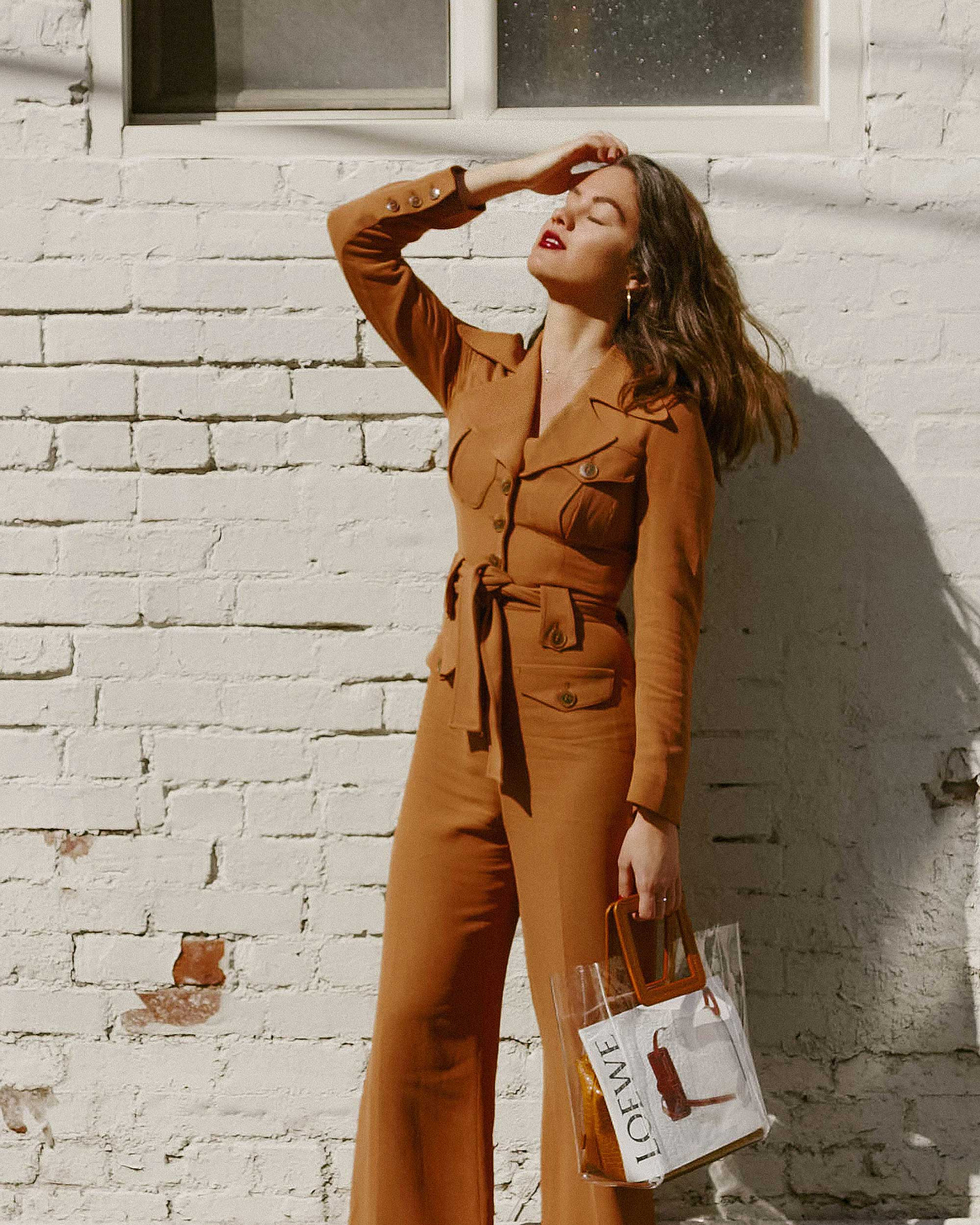 Sarah Butler of Sarah Styles Seattle wears & Other Stories Long Sleeve Belted Camel Jumpsuit and Staud Transparent Handbag in Seattle | @sarahchristine, Seattle Blogger.jpg