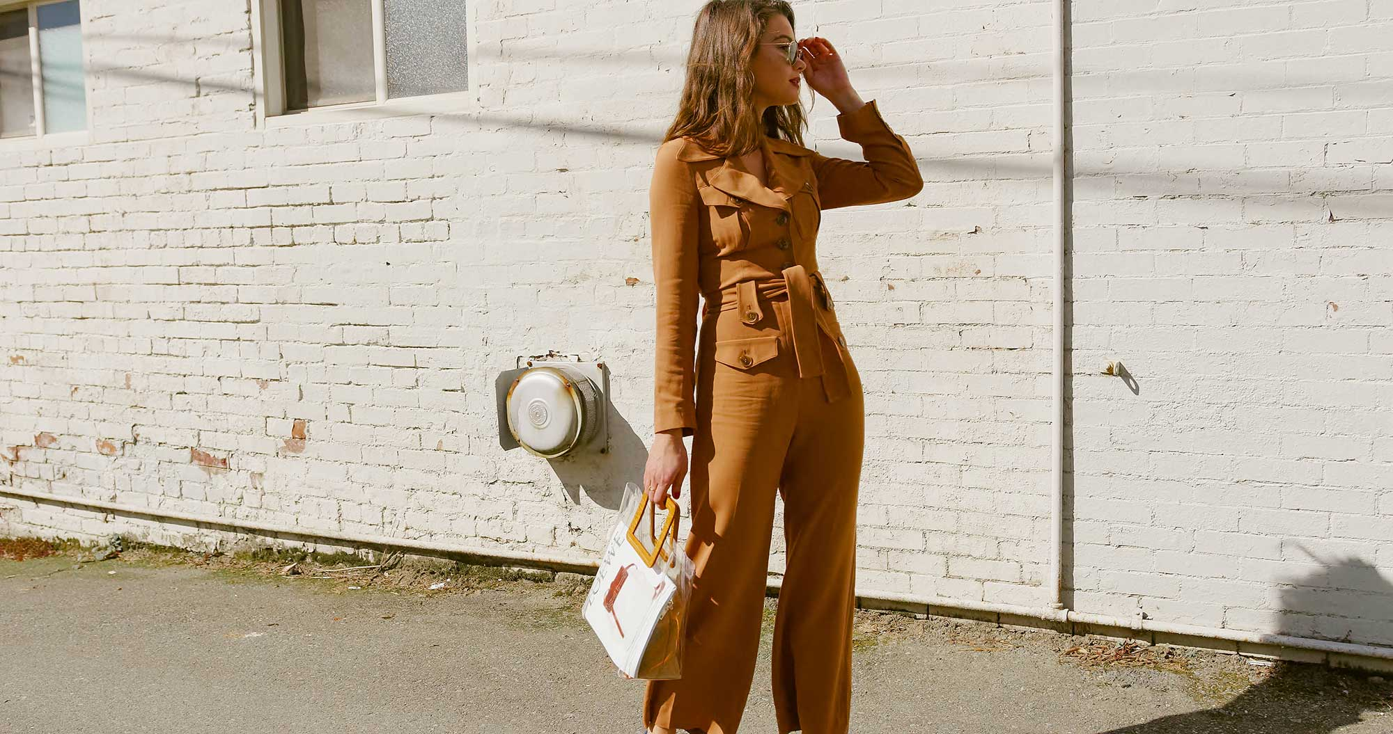 Sarah Butler of Sarah Styles Seattle wears & Other Stories Long Sleeve Belted Camel Jumpsuit and Staud Transparent Handbag in Seattle | @sarahchristine, Seattle Blogger1234.jpg