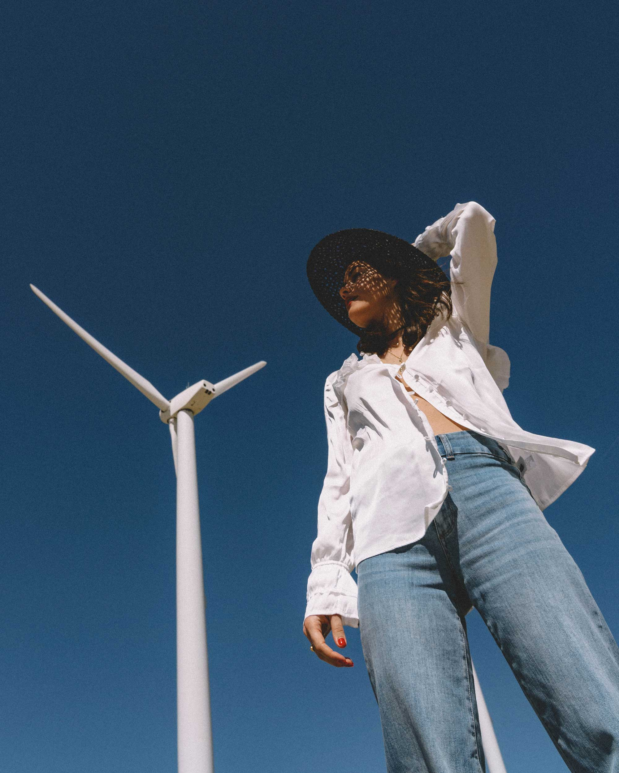Sarah Butler of Sarah Styles Seattle wears Paige Anguilla Long-Sleeve Blouse with Layered Ruffle Trim, Paige Sutton High Waist Wide Leg Jeans, and Lack of Color Women's Sunnydip Noir Hat in Palm Springs for Coachella Festival Outfit | @sarahchristine5.jpg