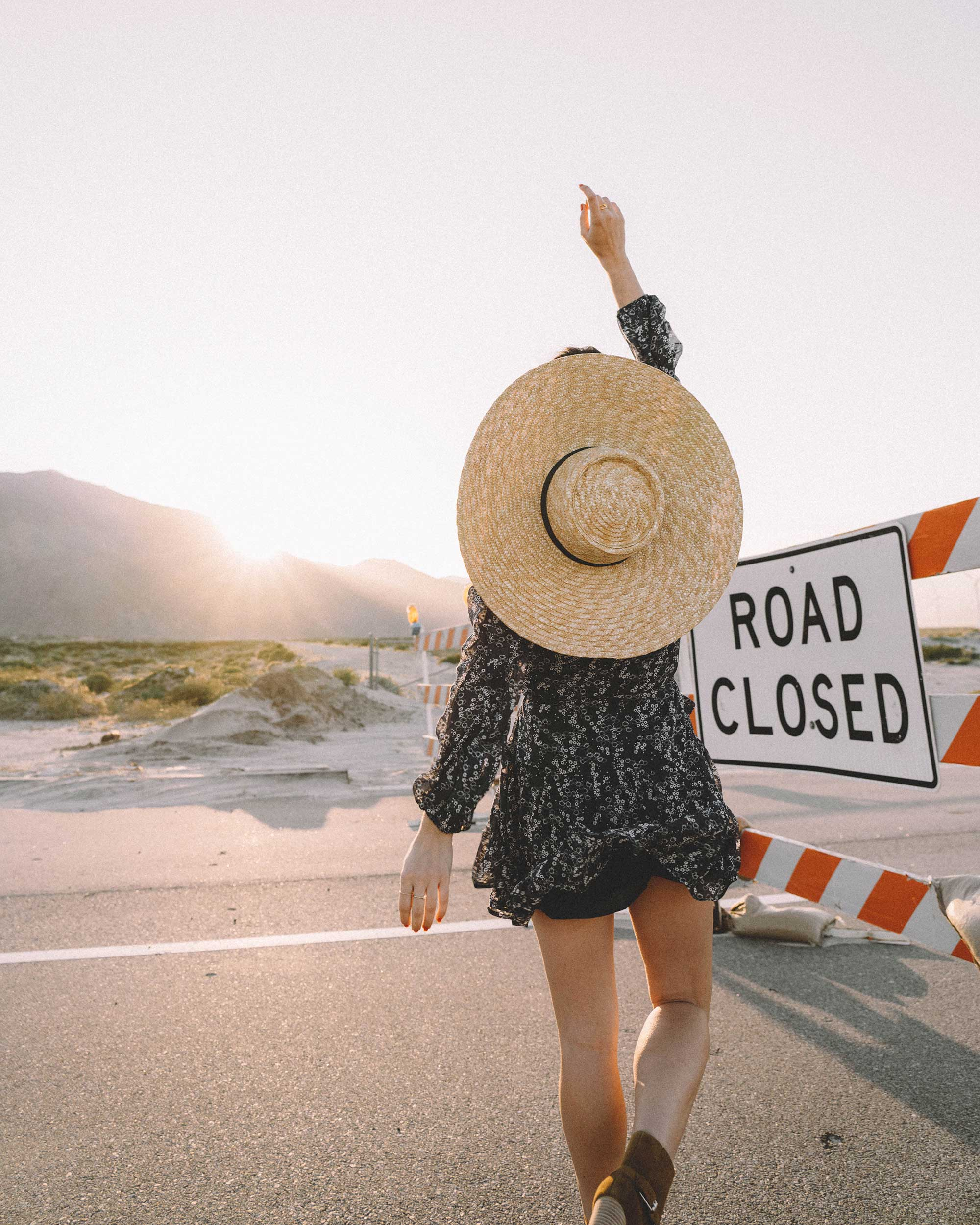 Road Closed - Paige Marjoram long-sleeve blue floral mini dress, & Other Stories round top straw hat with ribbon neck ties, and Paige suede western boot in Palm Springs for Coachella festival outfit
