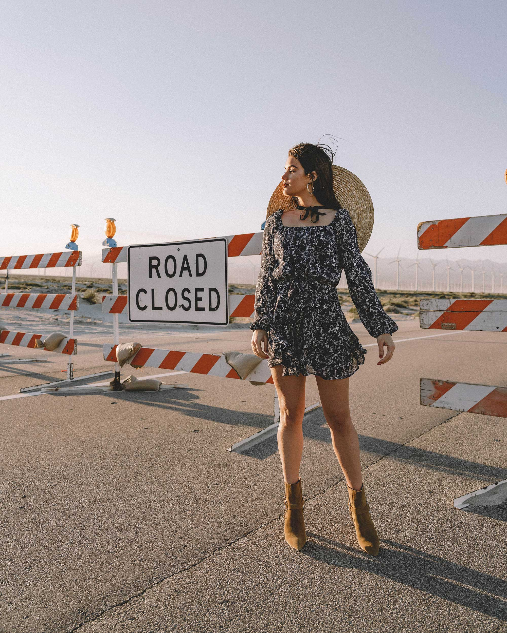 Sarah Butler of Sarah Styles Seattle wears PAIGE Marjoram Long-Sleeve Blue Floral Mini Dress, & Other Stories Round Top Straw Hat with ribbon neck ties, Paige Suede Western Boot in Palm Springs for Coachella Festival Outfit | @sarahchristine -6.jpg