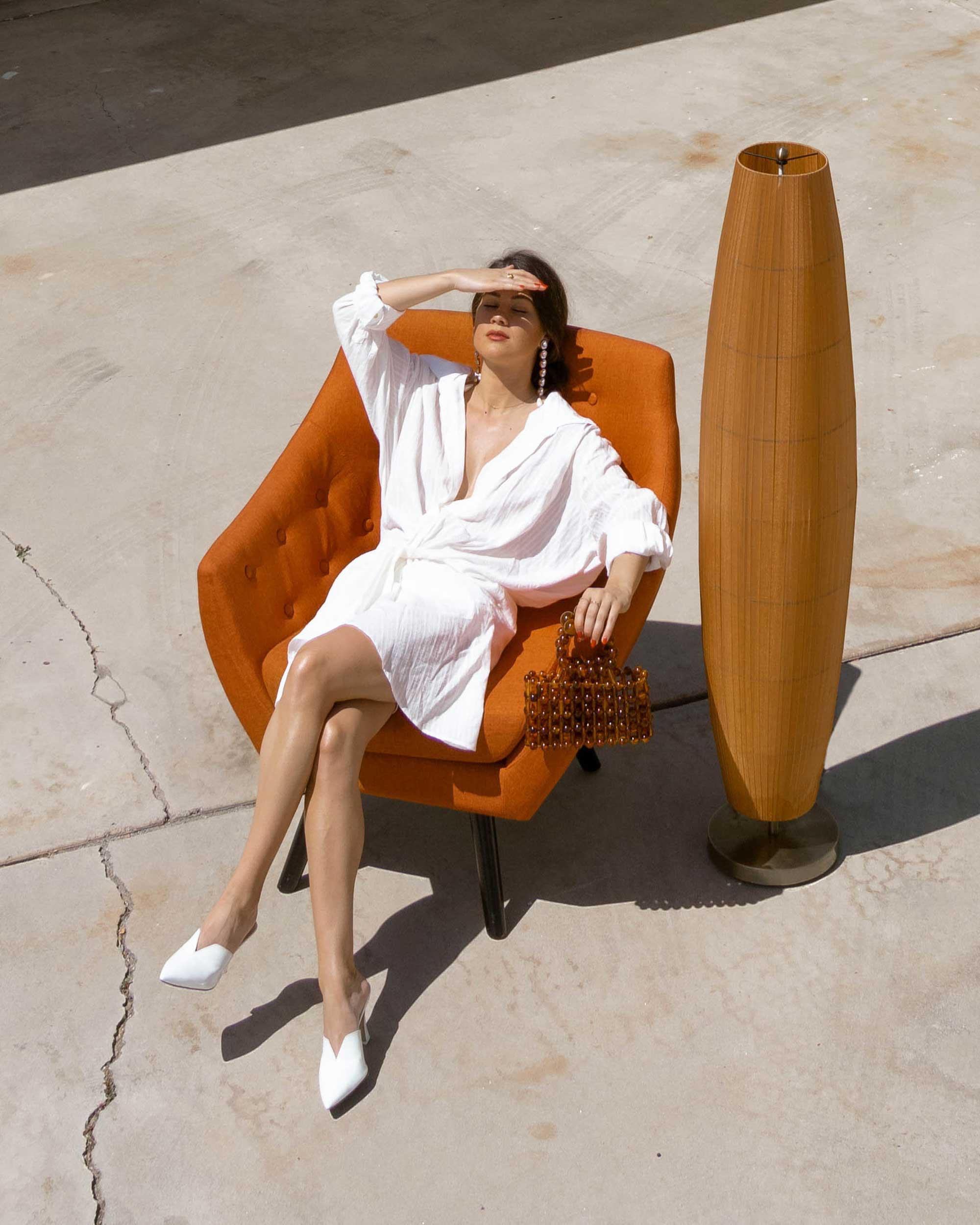 Sarah Butler of Sarah Styles Seattle wears Jacquemus Alassio draped white cotton mini dress and Cult Gaia Acrylic Cora Clutch in tortoise shell brown Palm Springs Outfit | @sarahchristine 9.jpg