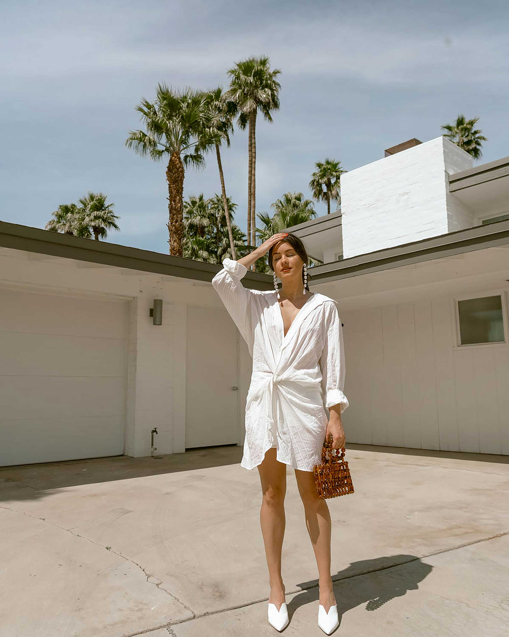 Sarah Butler of Sarah Styles Seattle wears Jacquemus Alassio draped white cotton mini dress and Cult Gaia Acrylic Cora Clutch in tortoise shell brown Palm Springs Outfit | @sarahchristine 4.jpg
