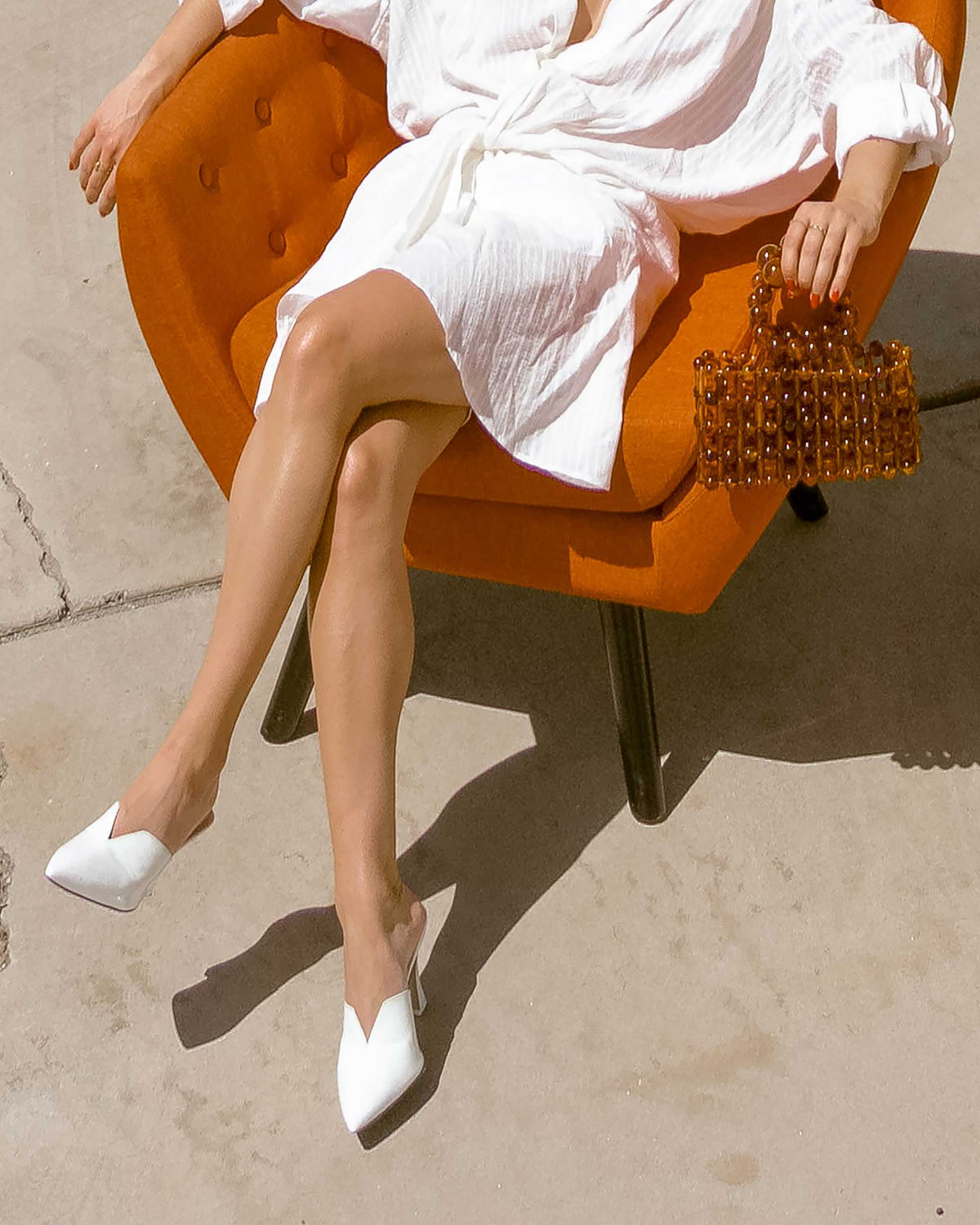 Sarah Butler of Sarah Styles Seattle wears Jacquemus Alassio draped white cotton mini dress and Cult Gaia Acrylic Cora Clutch in tortoise shell brown Palm Springs Outfit | @sarahchristine 2.jpg