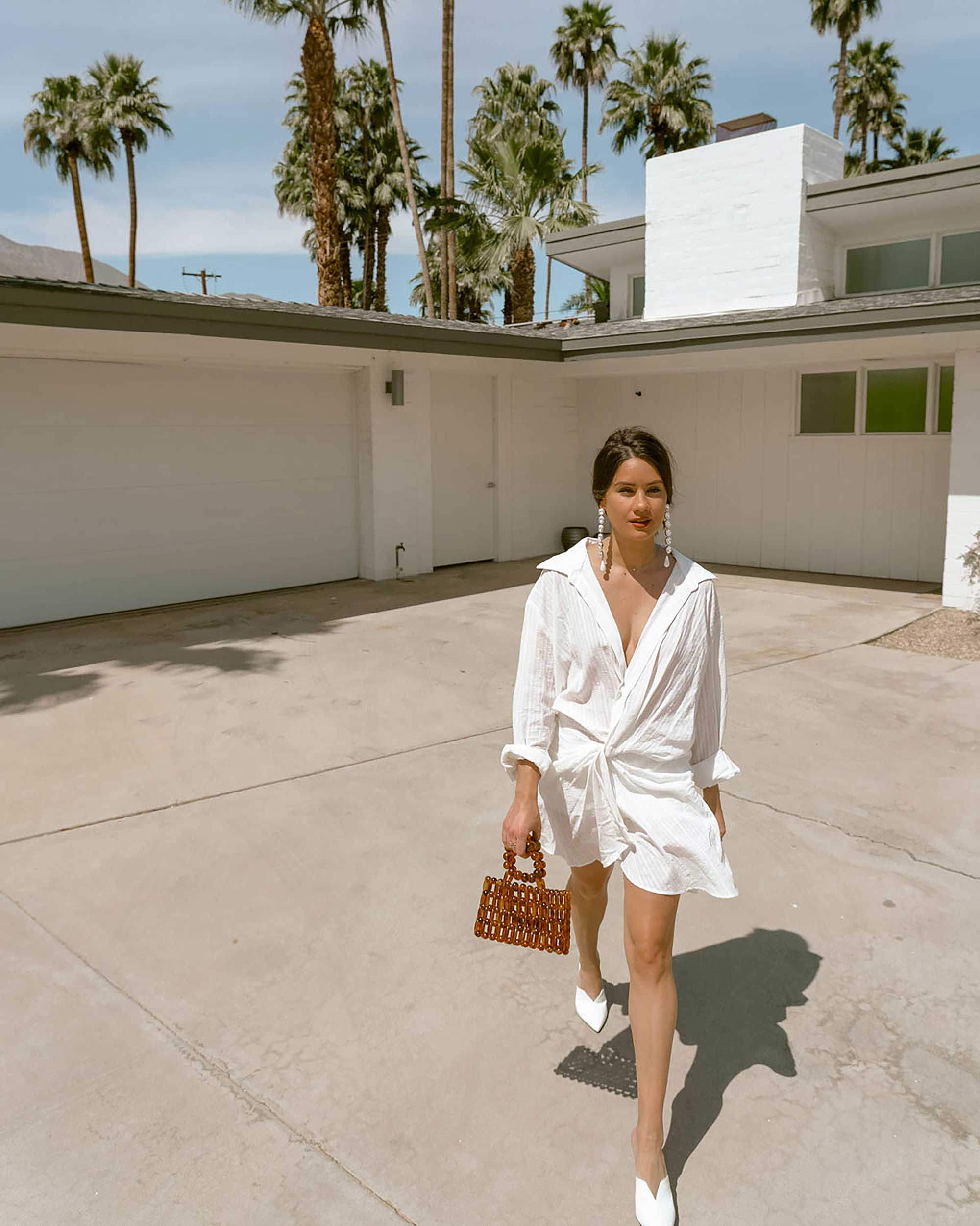 Sarah Butler of Sarah Styles Seattle wears Jacquemus Alassio draped white cotton mini dress and Cult Gaia Acrylic Cora Clutch in tortoise shell brown Palm Springs Outfit | @sarahchristine 7.jpg