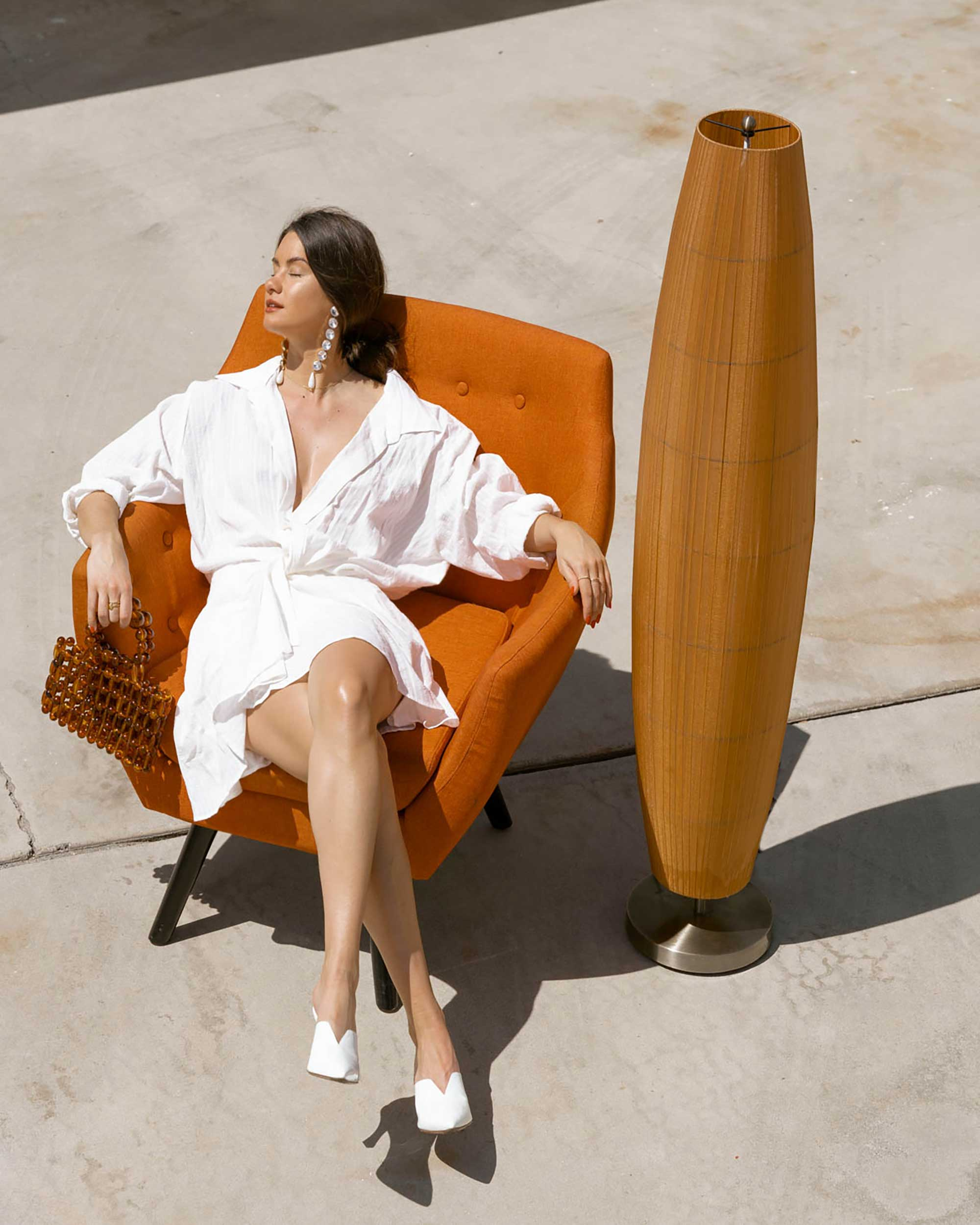 Sarah Butler of Sarah Styles Seattle wears Jacquemus Alassio draped white cotton mini dress and Cult Gaia Acrylic Cora Clutch in tortoise shell brown Palm Springs Outfit | @sarahchristine 10.jpg