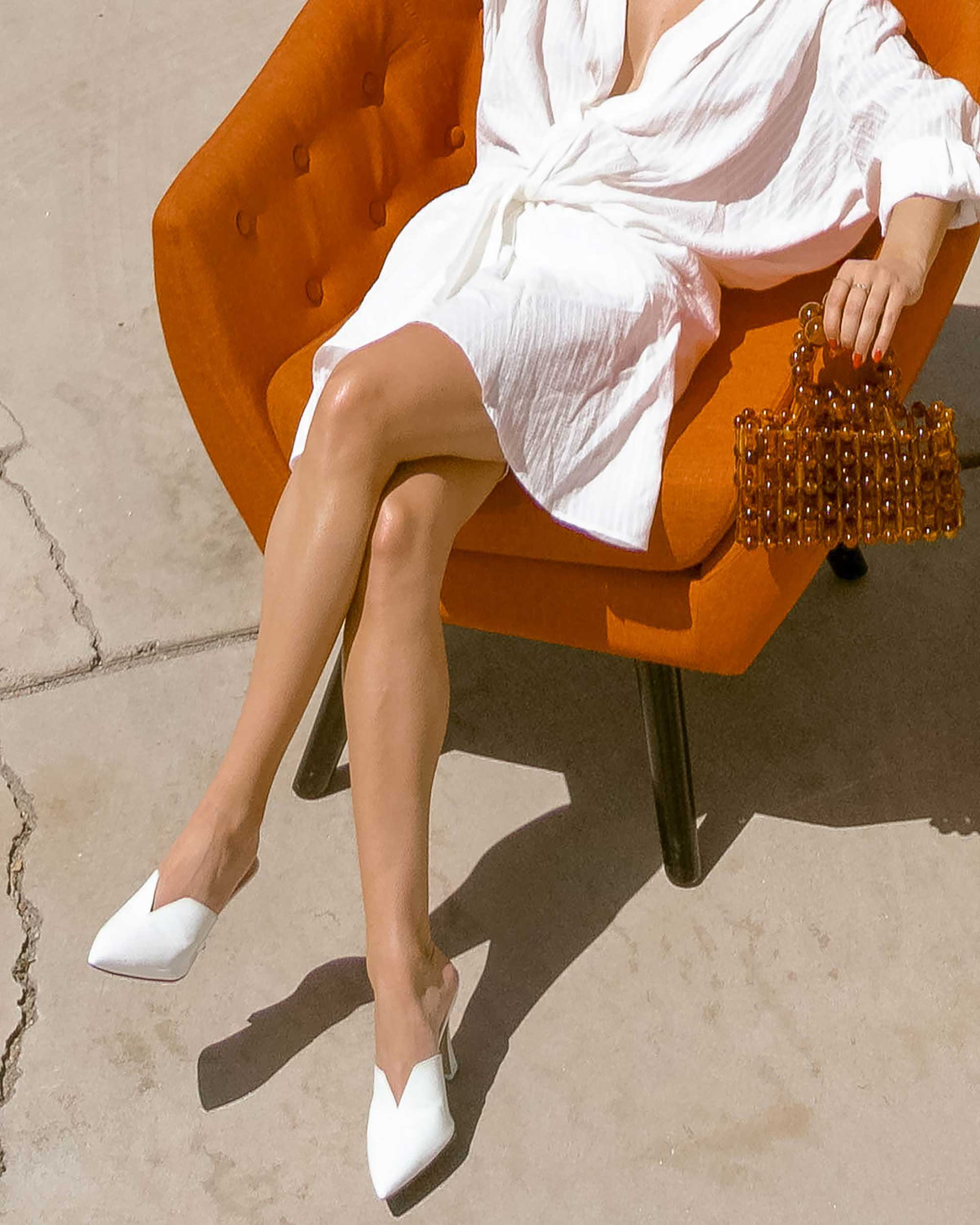 Sarah Butler of Sarah Styles Seattle wears Jacquemus Alassio draped white cotton mini dress and Cult Gaia Acrylic Cora Clutch in tortoise shell brown Palm Springs Outfit | @sarahchristine 3.jpg