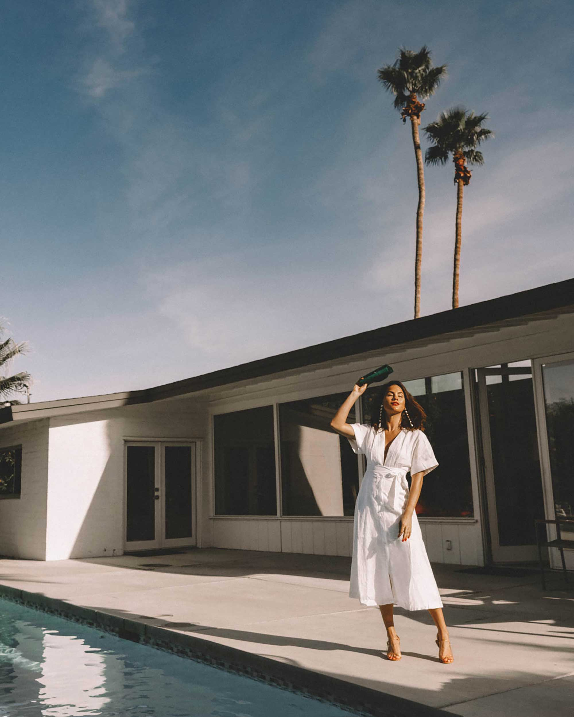 Sarah Butler of Sarah Styles Seattle wears Nauman Linen Dress in Bright White and Ferragamo Mini Gancini Top Handle Wallet in Palm Springs Outfit | @sarahchristine -8.jpg
