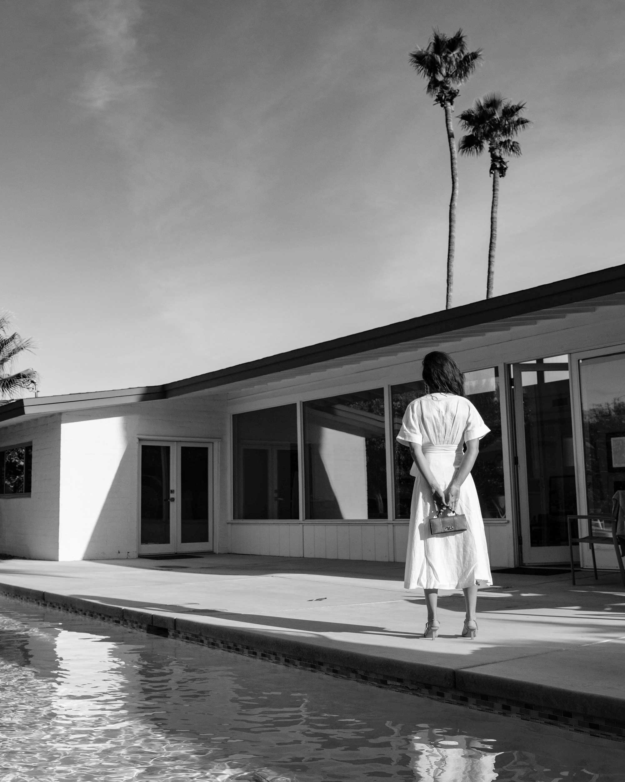 Sarah Butler of Sarah Styles Seattle wears Nauman Linen Dress in Bright White and Ferragamo Mini Gancini Top Handle Wallet in Palm Springs Outfit | @sarahchristine.jpg