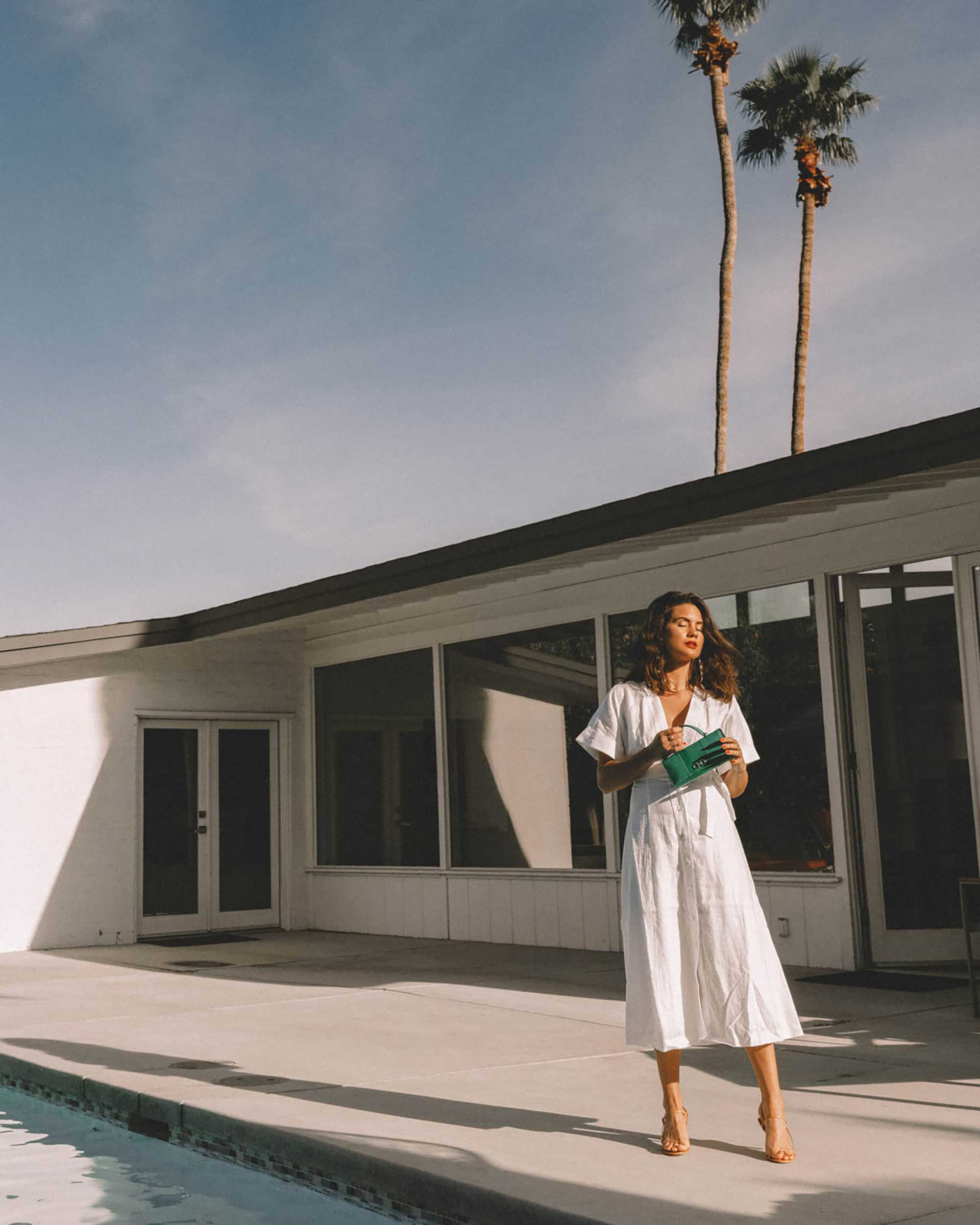 Sarah Butler of Sarah Styles Seattle wears Nauman Linen Dress in Bright White and Ferragamo Mini Gancini Top Handle Wallet in Palm Springs Outfit | @sarahchristine -9.jpg