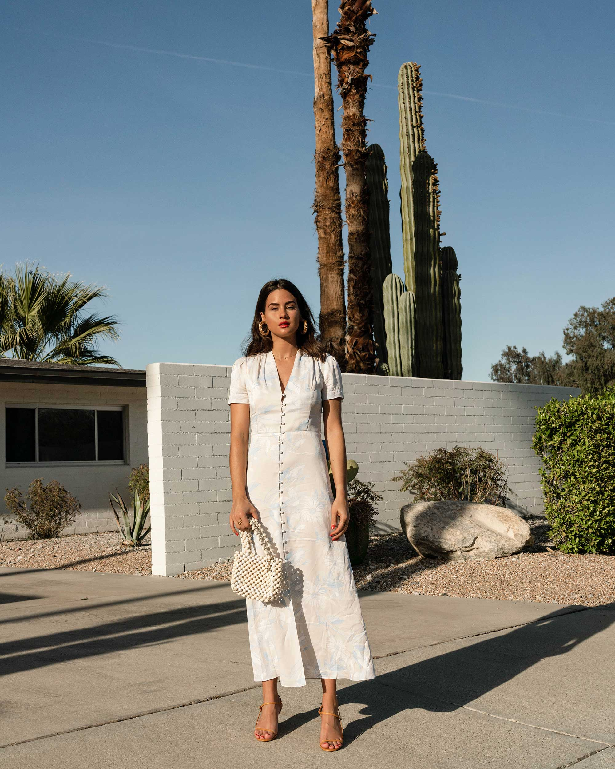 Sarah Butler of Sarah Styles Seattle wears Equipment Gaetan button front floral midi dress and ROSANTICA Patti beaded tote in Palm Springs Outfit | @sarahchristine -9.jpg