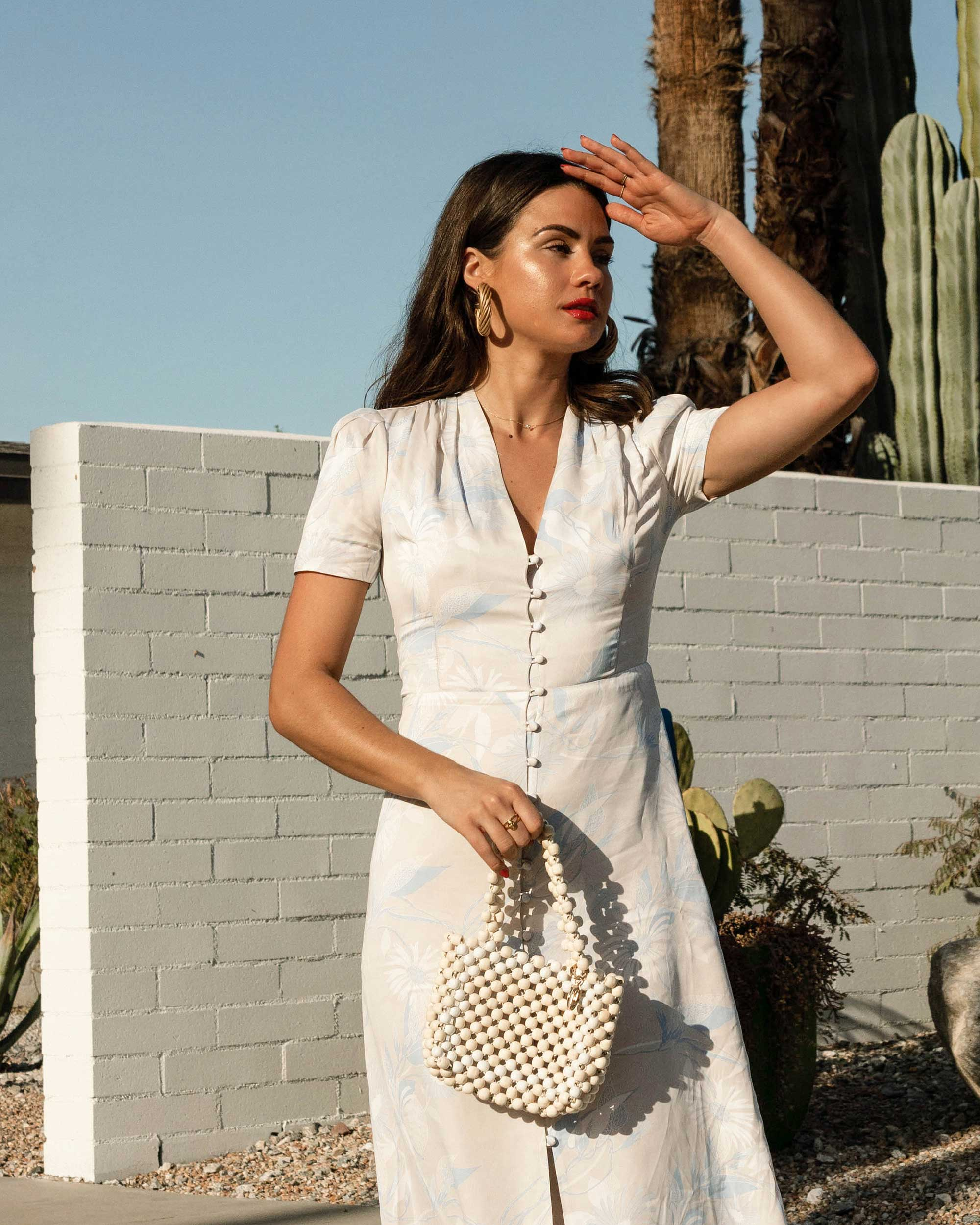 Sarah Butler of Sarah Styles Seattle wears Equipment Gaetan button front floral midi dress and ROSANTICA Patti beaded tote in Palm Springs Outfit | @sarahchristine -3.jpg