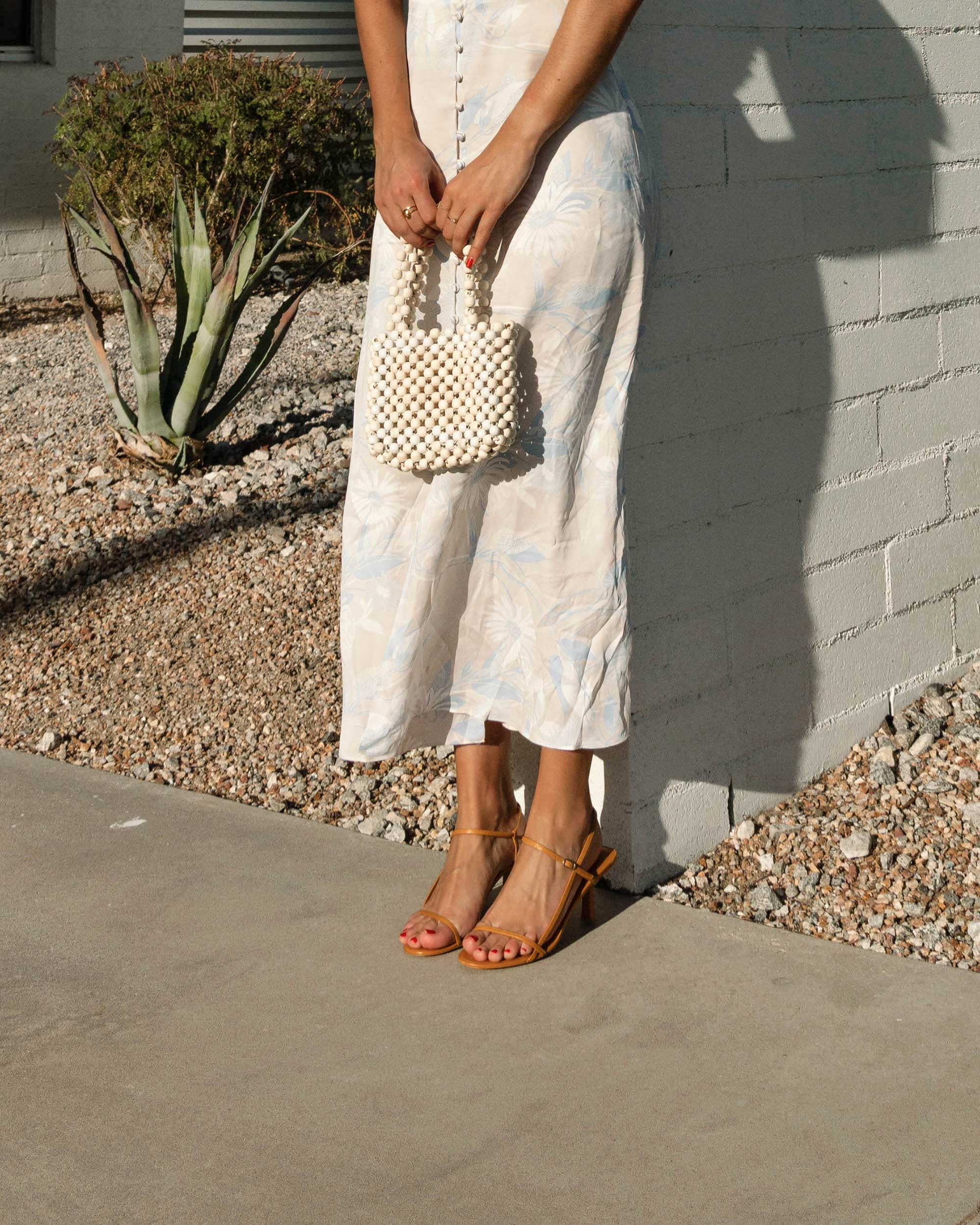 Sarah Butler of Sarah Styles Seattle wears Equipment Gaetan button front floral midi dress and ROSANTICA Patti beaded tote in Palm Springs Outfit | @sarahchristine -2.jpg