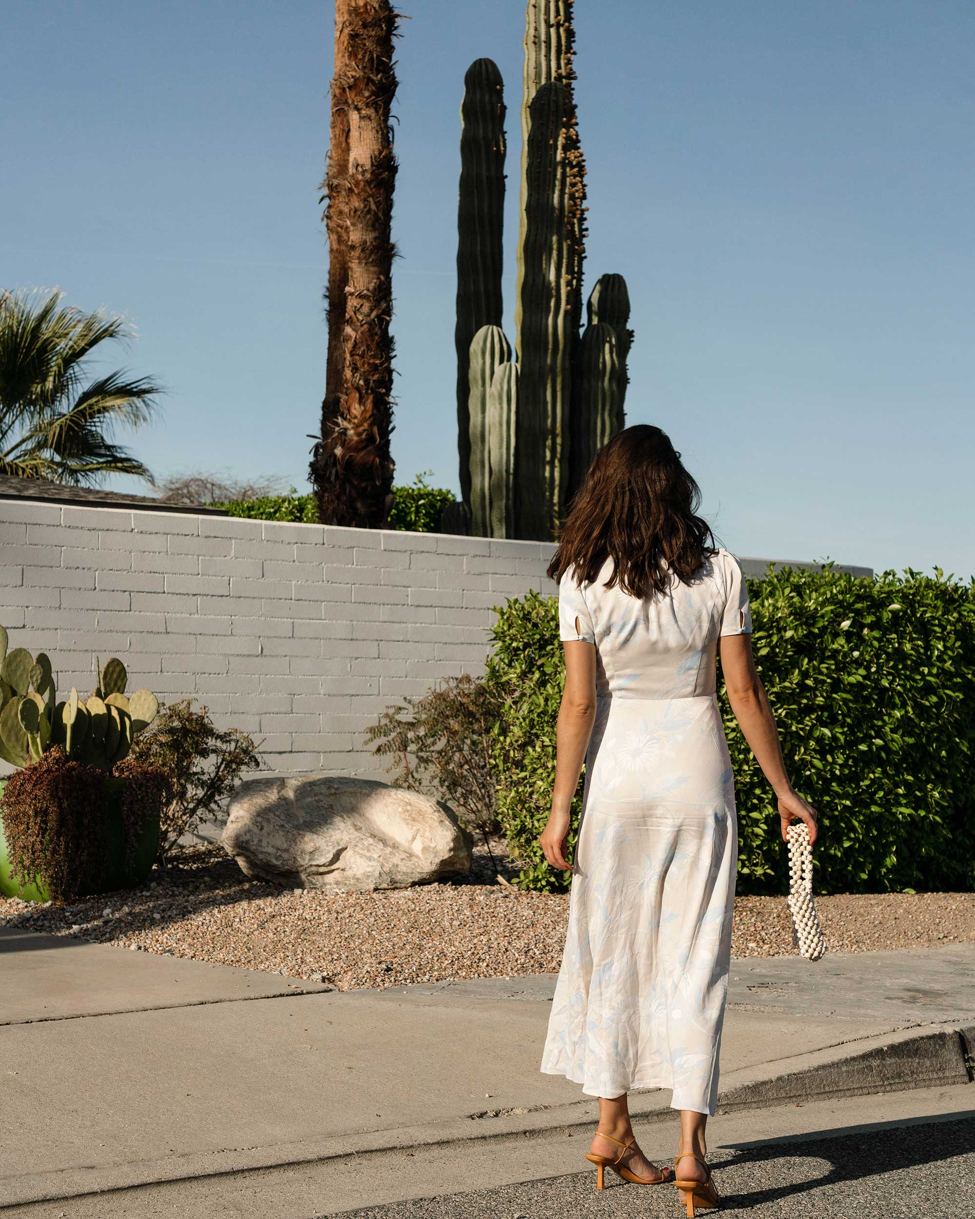 Sarah Butler of Sarah Styles Seattle wears Equipment Gaetan button front floral midi dress and ROSANTICA Patti beaded tote in Palm Springs Outfit | @sarahchristine -6.jpg