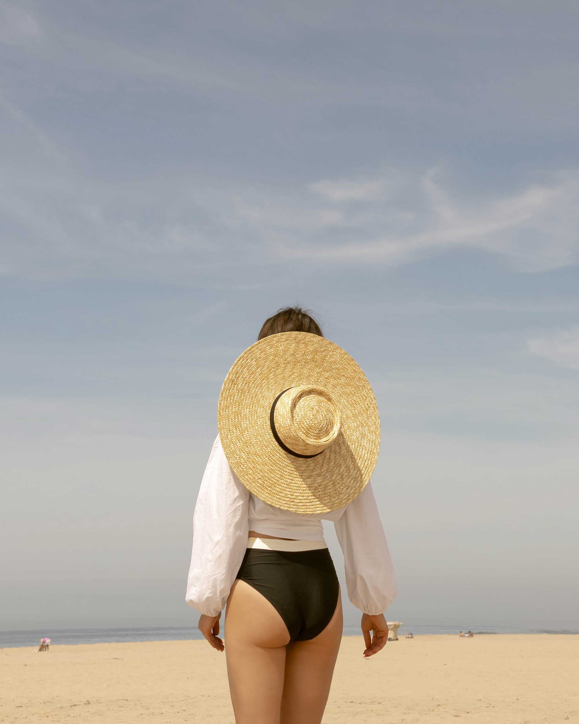 Sarah Butler of Sarah Styles Seattle wears C:Meo Collective puff sleeve Coco shirt in white and & Other Stories Round Top Straw Hat with Ribbon Neck Ties for the perfect summer beach outfit | @sarahchristine -4.jpg