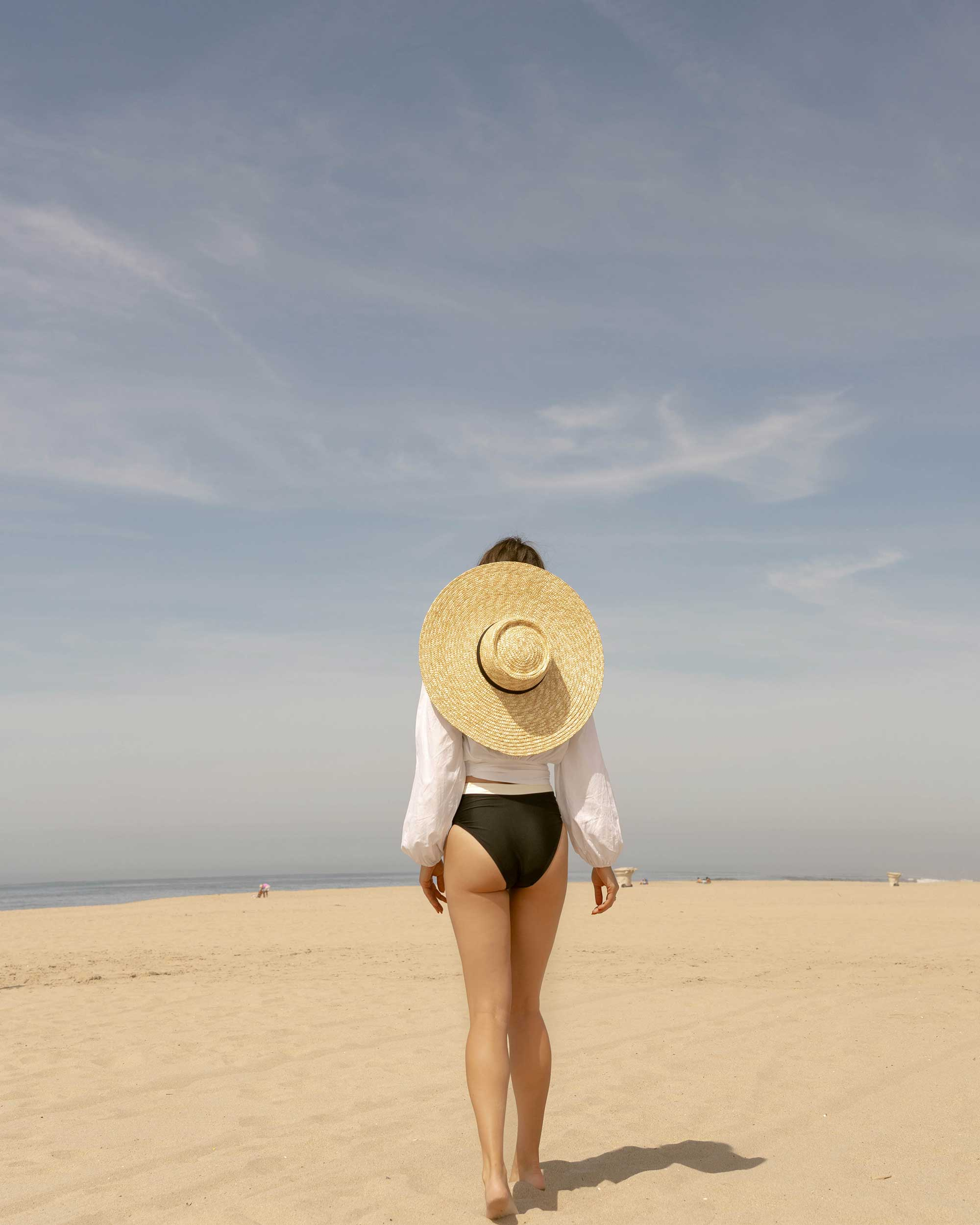CALIFORNIA BEACH BUM - C/Meo Collective puff sleeve Coco shirt in white and & Other Stories round top straw hat with ribbon neck ties for the perfect summer beach outfit